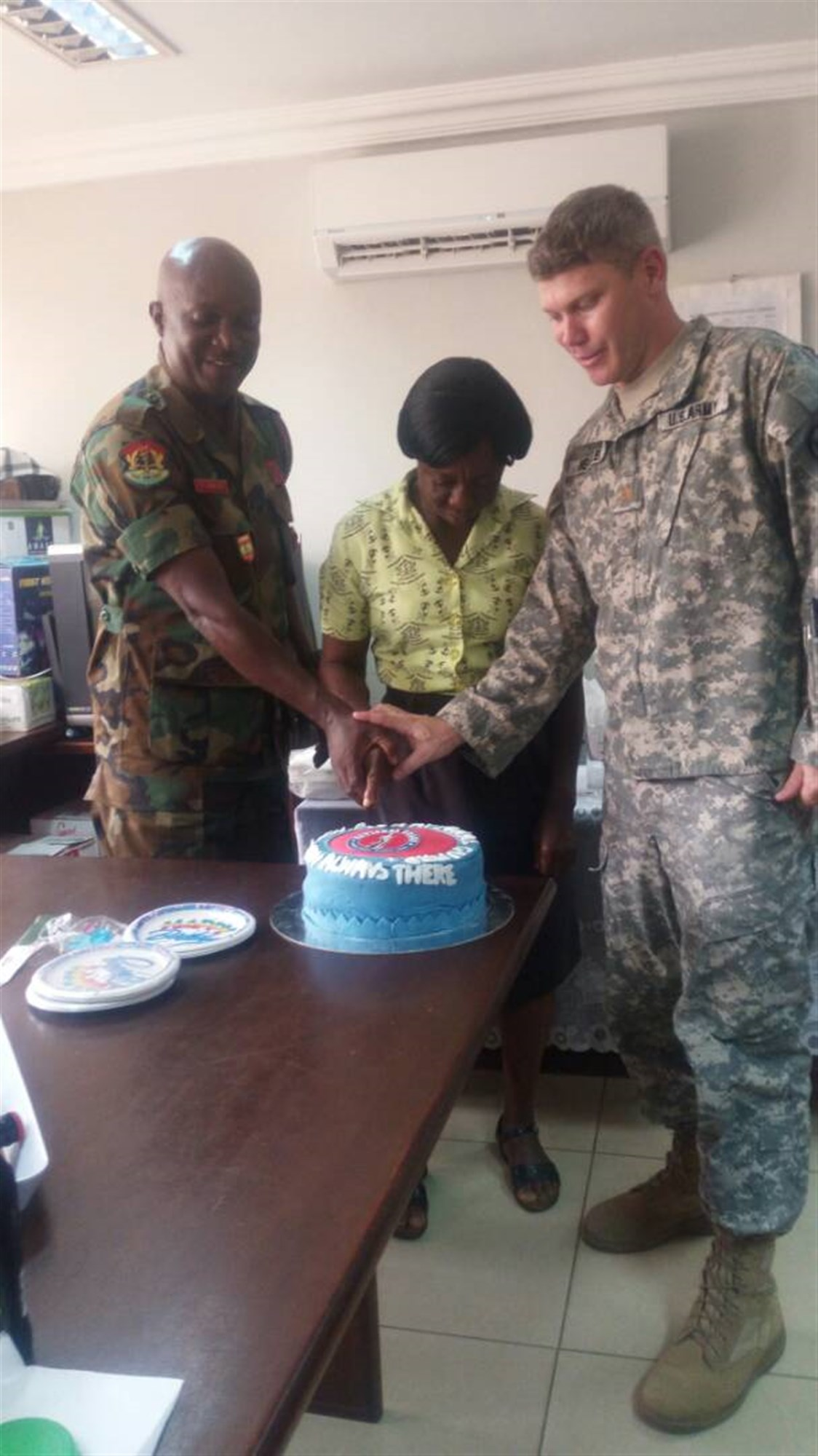 Maj. Matt Headley of North Dakota National Guard and Ghana/Togo/Benin Bilateral Affairs Officer and the Ghana Forces Sergeant Major Chief Warrant Officer Ramous Kwame Barker cut cake to celebrate the National Guard Birthday.