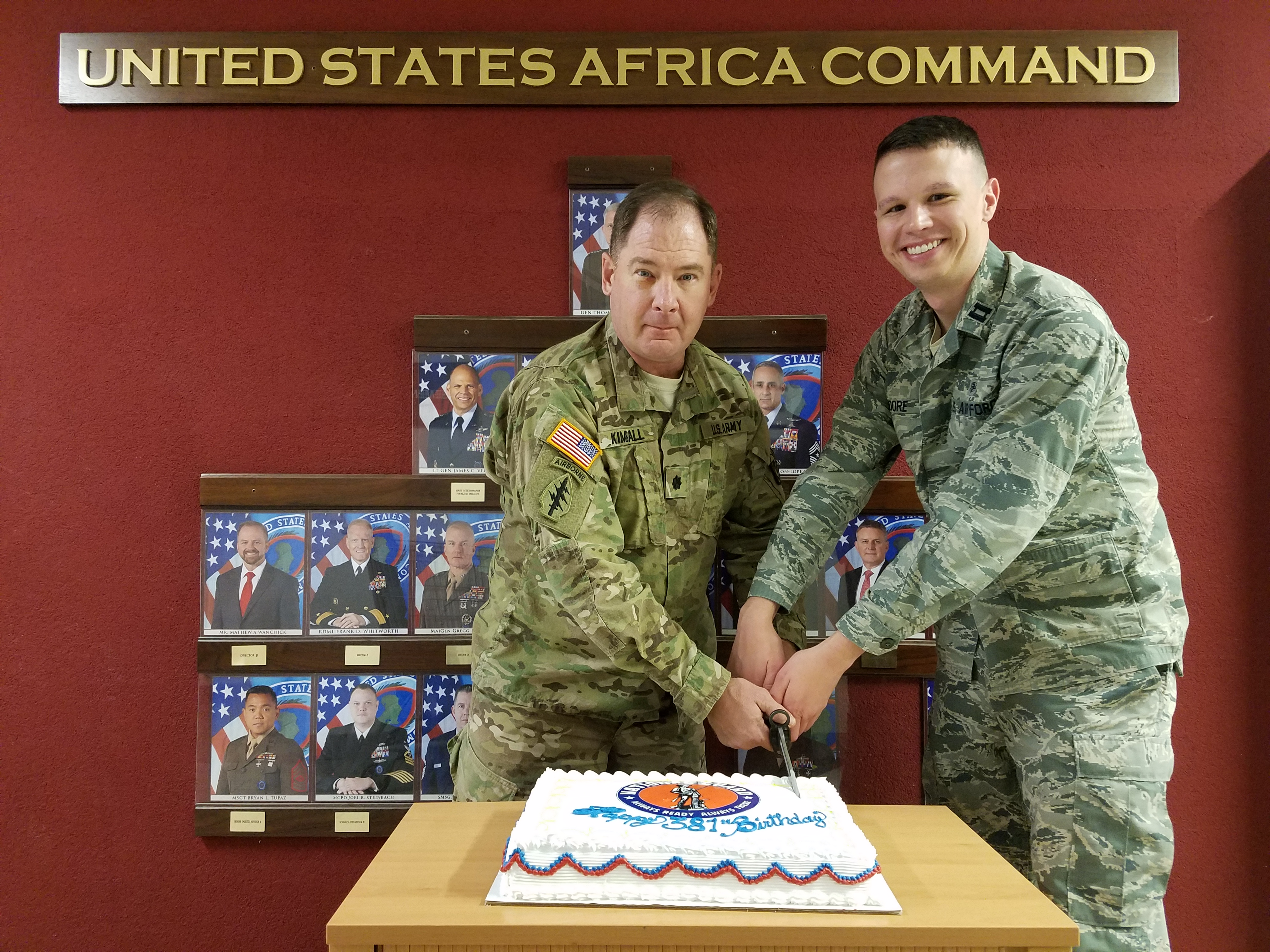 Lt. Col. Chris Kimball and Capt David Moore, AFRICOM J5 National Guard Integration Office, cut cake during the National Guard Birthday celebration at the U.S. Africa Command headquarters in Stuttgart, Germany.