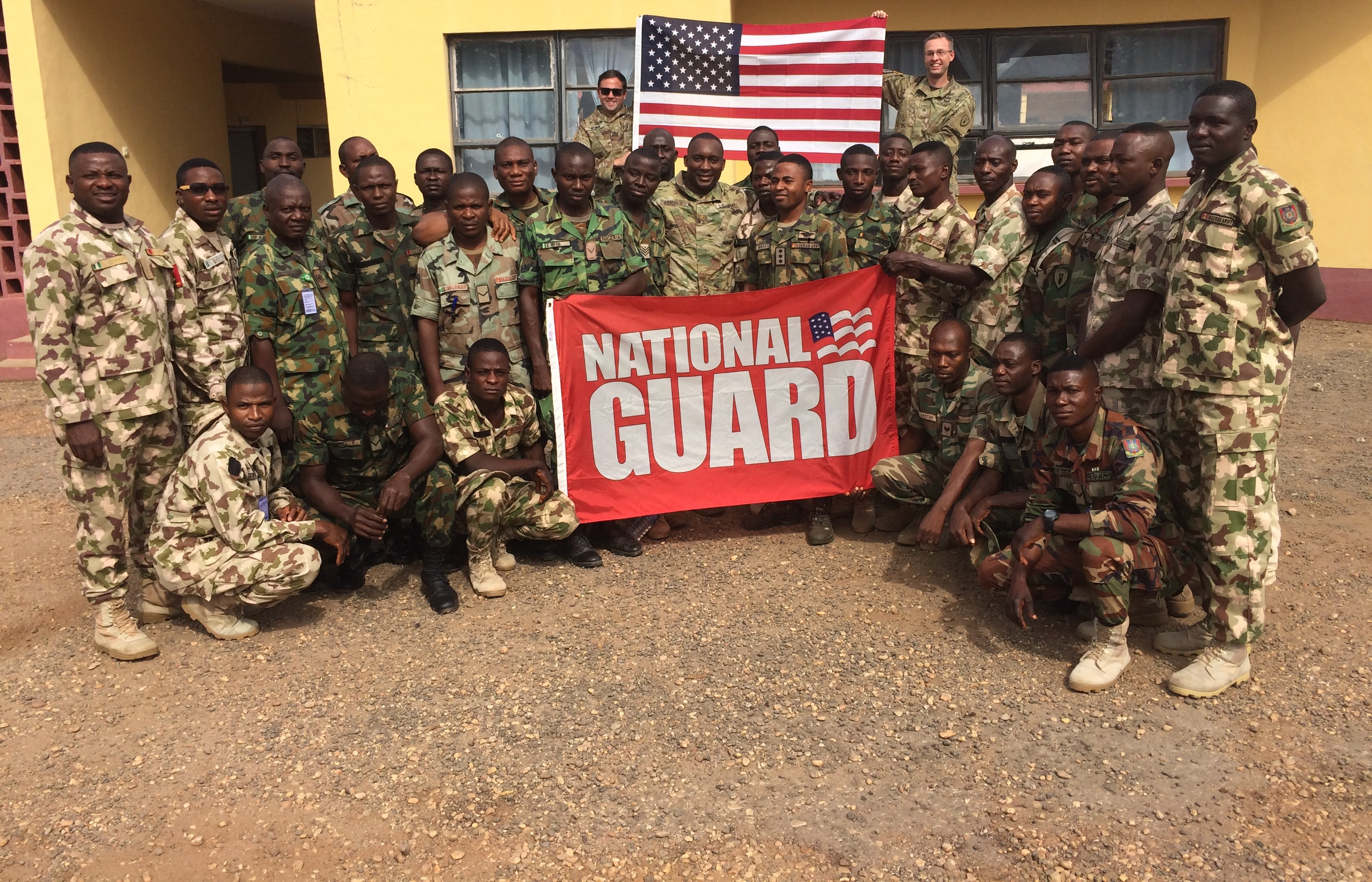 MAJ Chiddy Adighije, California National Guard and Nigeria Bilateral Affairs Officer and members of the Nigerian Army pose for a photo to celebrate the National Guard Birthday.