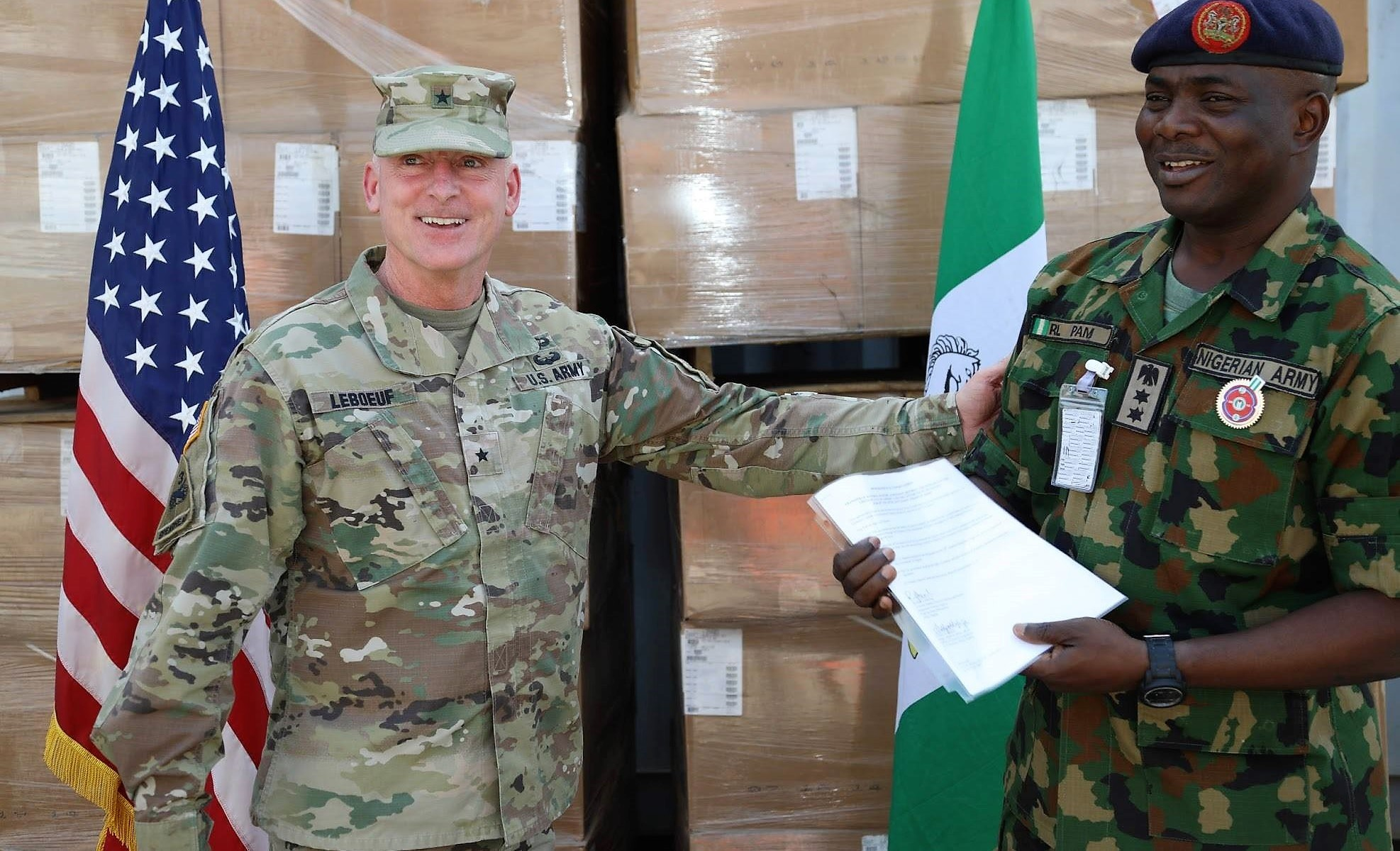 Brig. Gen. Eugene LeBoeuf, the U.S. Army Africa acting commanding general, meets with Col. R.L. Pam during an equipment handover between the U.S. Embassy to Nigeria and Nigeria army's 20th Infantry Battalion in Abuja, Nigeria. A team of Soldiers from U.S. Army Security Assistance Command will deploy to Nigeria in January 2018 to assist in training for the Nigerian army.  (Courtesy photo/U.S. Embassy and Consulate in Nigeria)