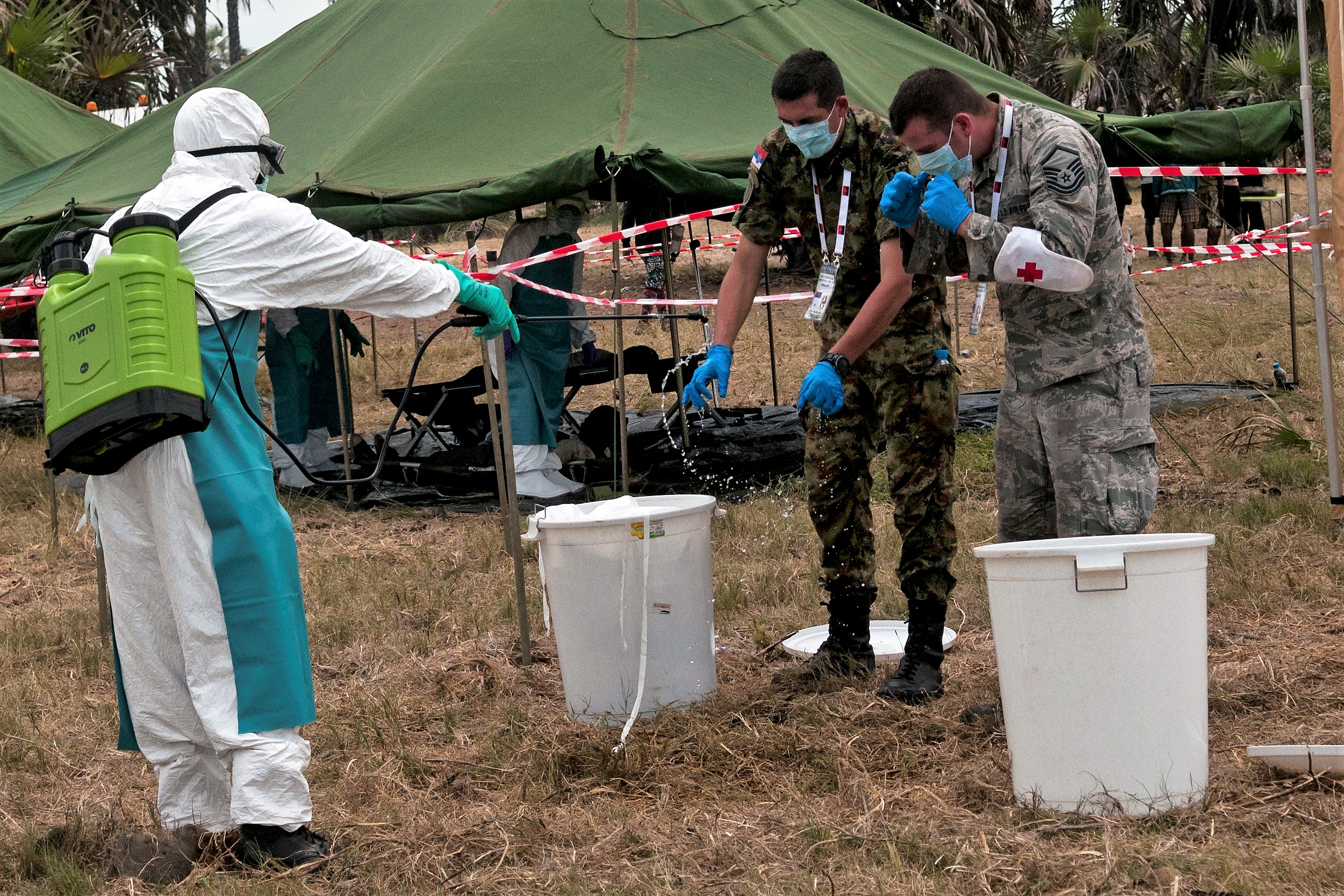 Master Sgt. Christopher Ice (right) of the Ohio Air National Guard and a member of the Serbian Armed Forces (center) take part in a demonstration of a simulated epidemic infectious disease outbreak during the VIP day and closing ceremony for PAMBALA 2017, Dec. 14, 2017, in Bengo Province, Angola. Highlights of the event included a demonstration of an infectious disease crisis response by the Angolan police and firefighting units, the Angolan Armed Forces and some of the Serbian and Ohio National Guard personnel. (Ohio National Guard photo by Staff Sgt. Wendy Kuhn)