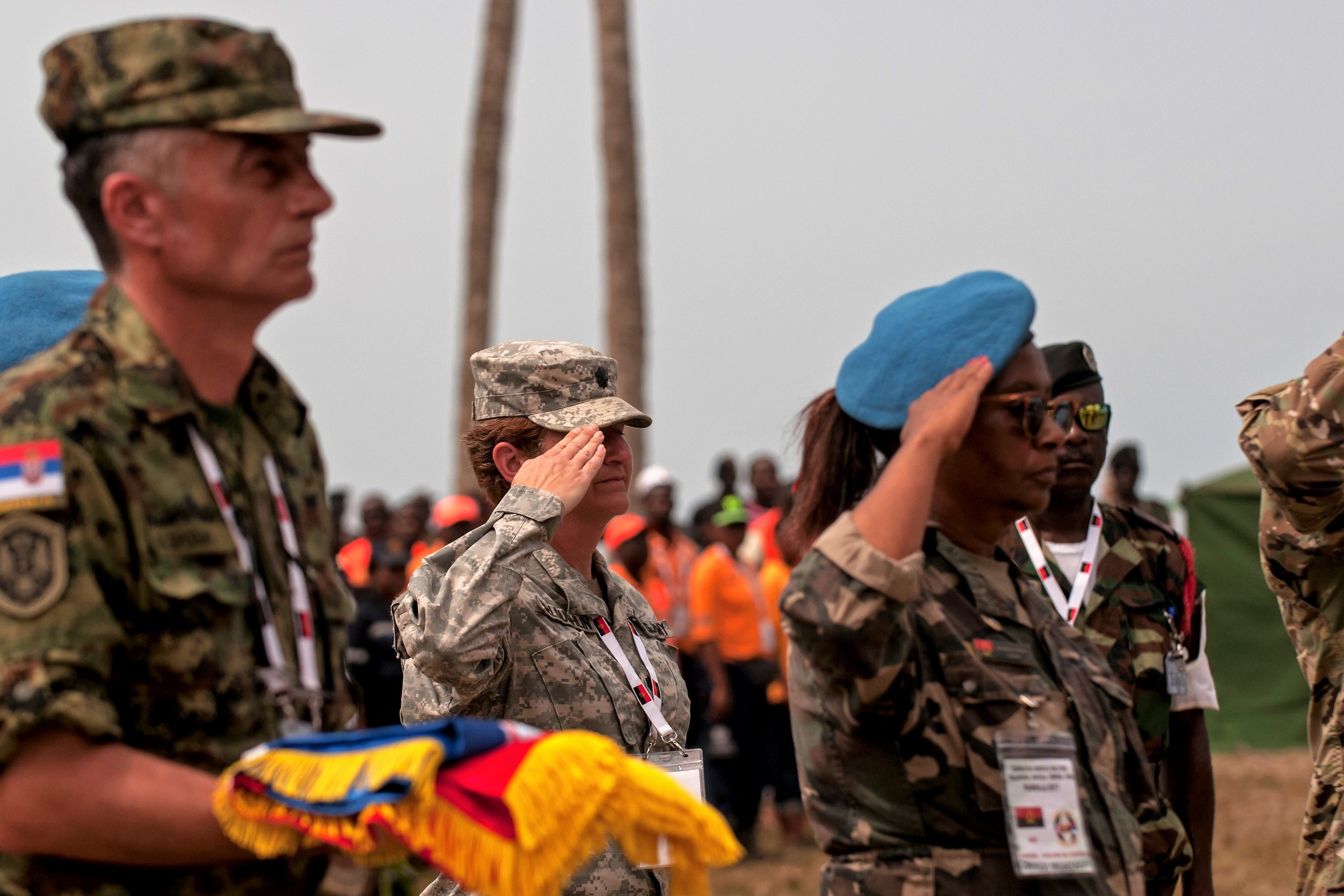 Lt. Col. Jill McLoughlin, a preventative medicine officer with the Ohio Army National Guard, represents the U.S. in the exchanging of flags during the closing ceremony for the PAMBALA 2017 exercise Dec. 14, 2017, in Bengo Province, Angola. Personnel from the Serbian Armed Forces and the Ohio National Guard exchanged flags with their host nation, the Republic of Angola, and remarks were given by representatives of each participating country on the success of the first-ever engagement. (Ohio National Guard photo by Staff Sgt. Wendy Kuhn)