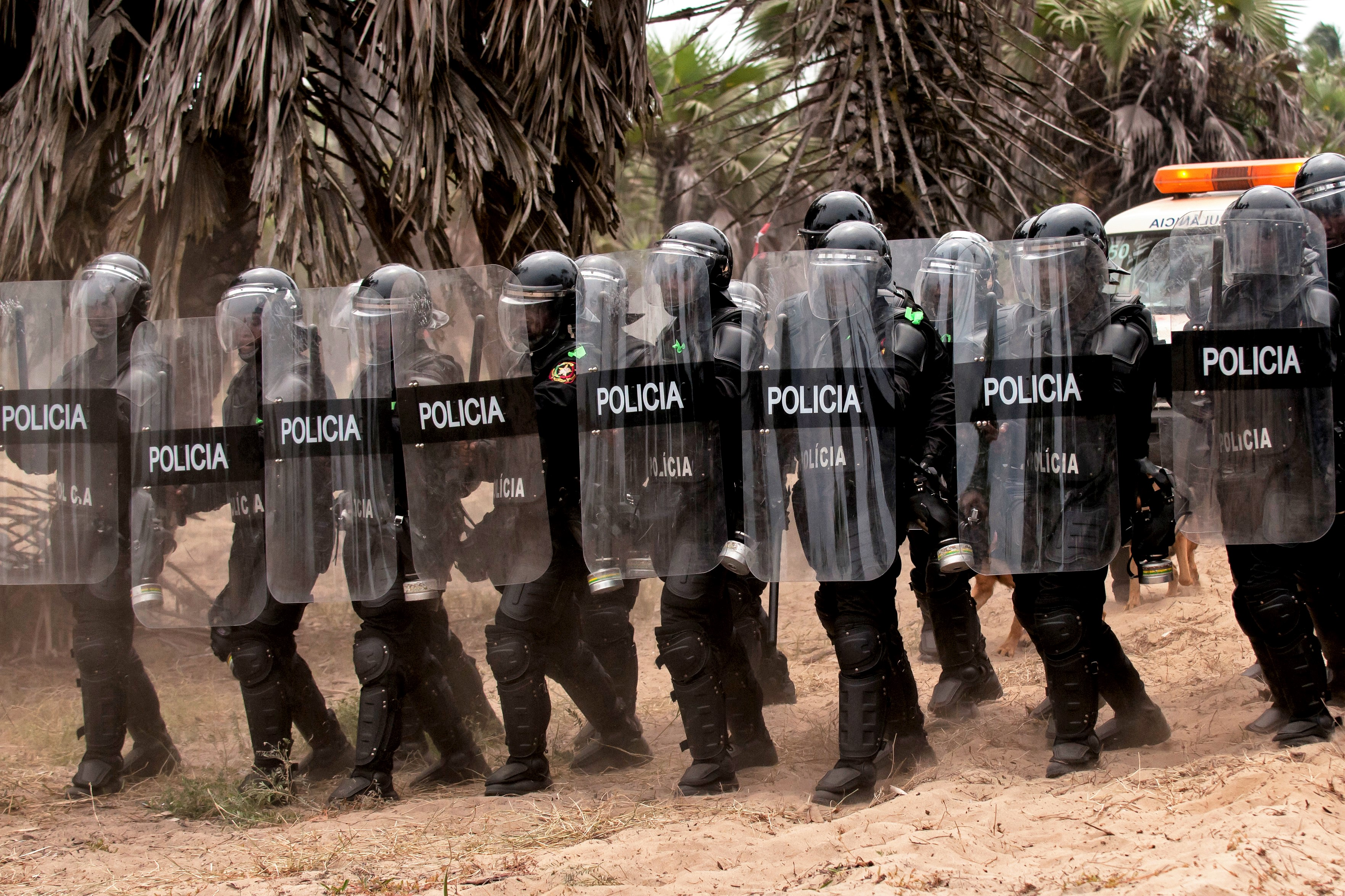Members of the Angolan police forces demonstrate a response to a riot situation during a simulated epidemic infectious disease outbreak during the VIP day and closing ceremony for PAMBALA 2017, Dec. 14, 2017, in Bengo Province, Angola. Highlights of the event included a demonstration of an infectious disease crisis response by the Angolan police and firefighting units, the Angolan Armed Forces and some of the Serbian and Ohio National Guard personnel. (Ohio National Guard photo by Staff Sgt. Wendy Kuhn)