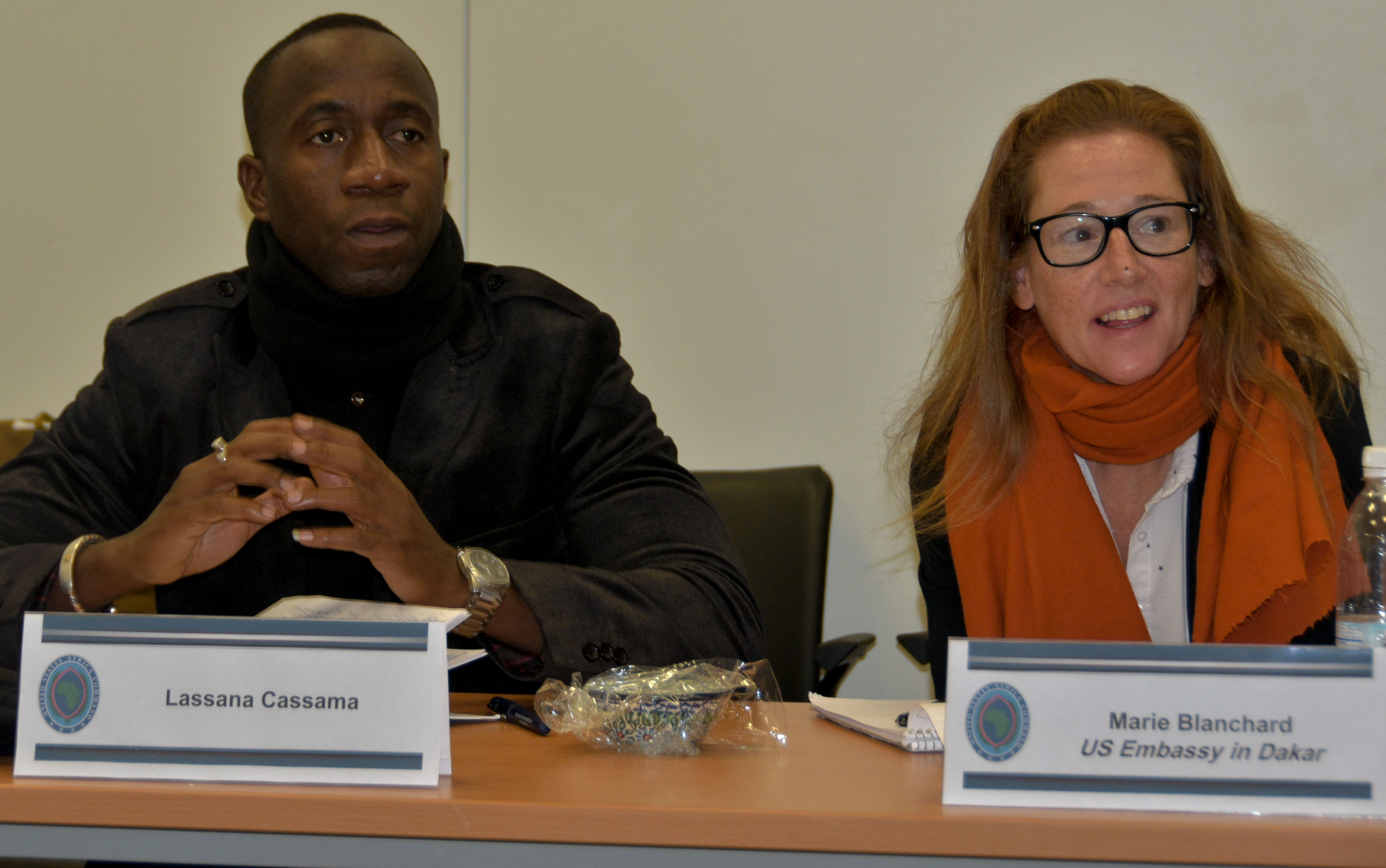 Lassana Gassama, editor of Capital Radio in Guinea Bissau, left, and Marie Blanchard, Press Attaché, U.S. Embassy in Dakar, listen to AFRICOM staff briefs.  Journalists from various news organizations in Senegal and Guinea Bissau visited U.S. Africa Command, Stuttgart, Germany, Dec. 11-14, 2017. AFRICOM staff provided briefs throughout the week which culminated in an interview of Lt. Gen. James C. Vechery, Deputy to the Commander for Military Operations, U.S. Africa Command.