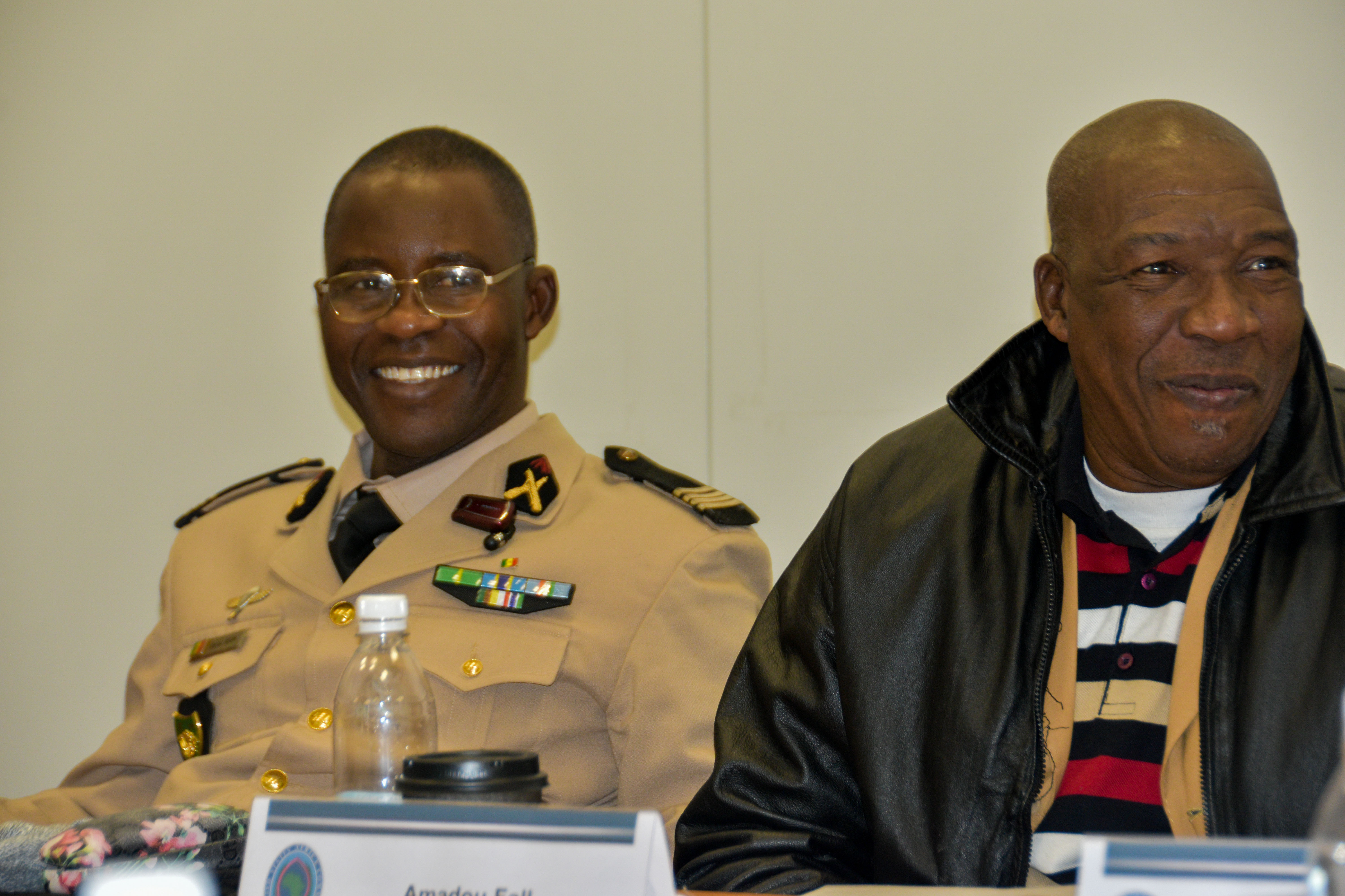 Commandant Saliou Ngom, Head of Media Strategies for the Senegal Armed Forces, and Amadou Fall, Publication Director of La Gazette, enjoy a light moment during a break.  Journalists from various news organizations in Senegal and Guinea Bissau visited U.S. Africa Command, Stuttgart, Germany, Dec. 11-14, 2017. AFRICOM staff provided briefs throughout the week which culminated in an interview of Lt. Gen. James C. Vechery, Deputy to the Commander for Military Operations, U.S. Africa Command.