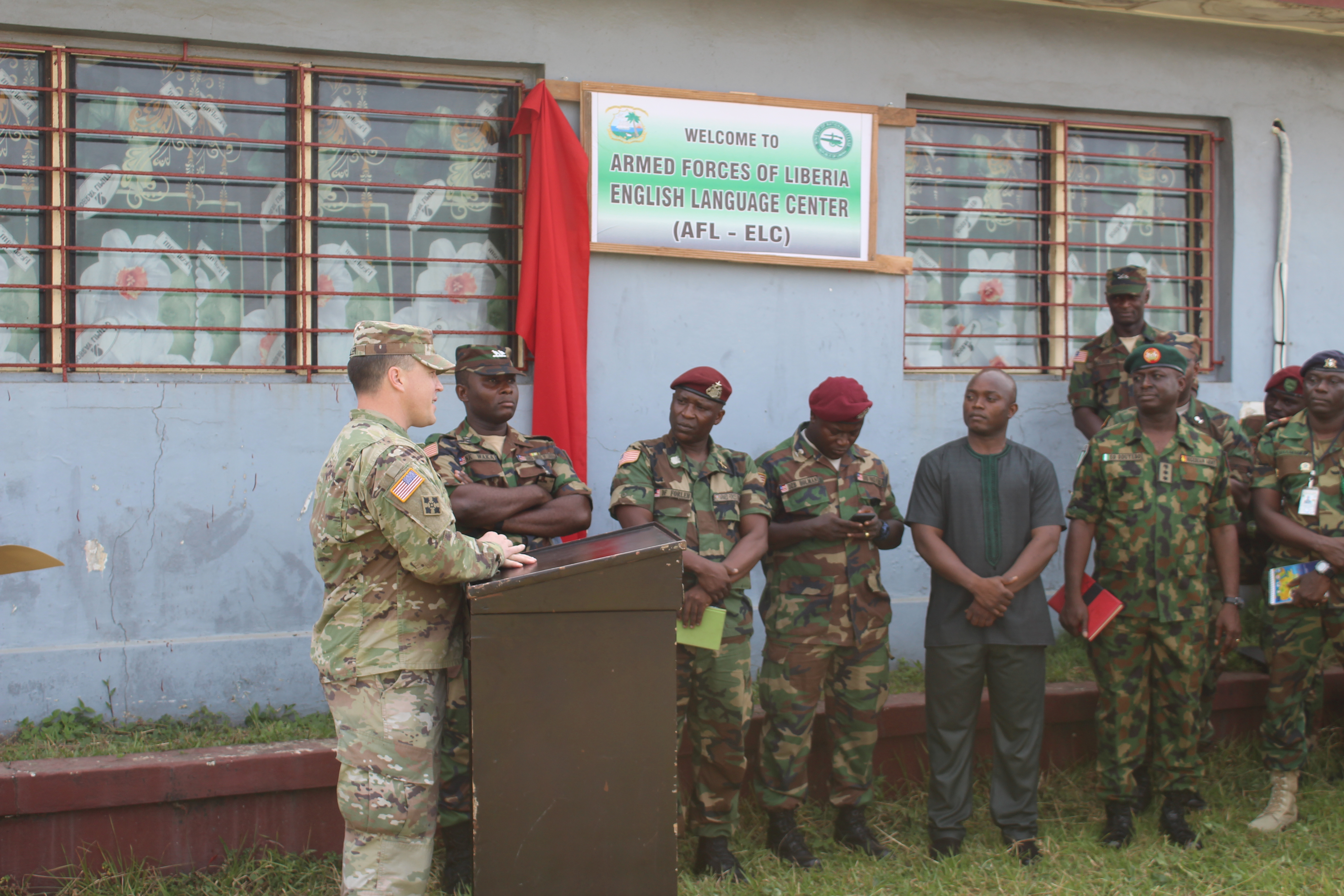 Maj. Michael Miller, Office of Security Cooperation Chief, U.S. Embassy Monrovia, gives welcome remarks during the dedication ceremony of the Armed Forces of Liberia English Language Center Jan 8, 2018.