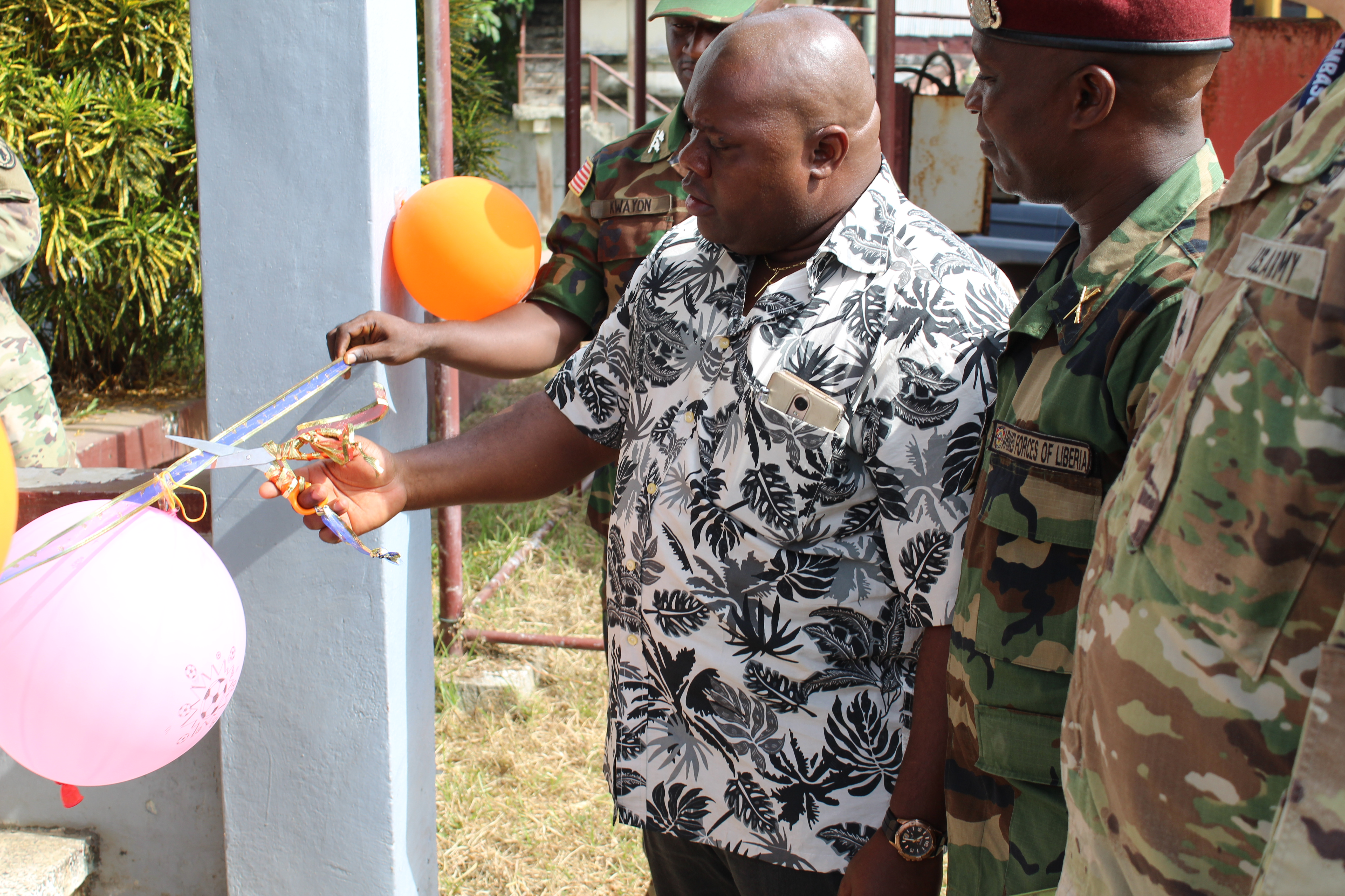 Liberian Deputy Minister of National Defense for Operations, Honorable St. Jerome Larblee, and Liberian Col. Davison Forleh, Commander, 23rd Infantry Brigade, cut the ribbon Jan. 8, 2018 formally opening the Armed Forces of Liberia's English Language Center.