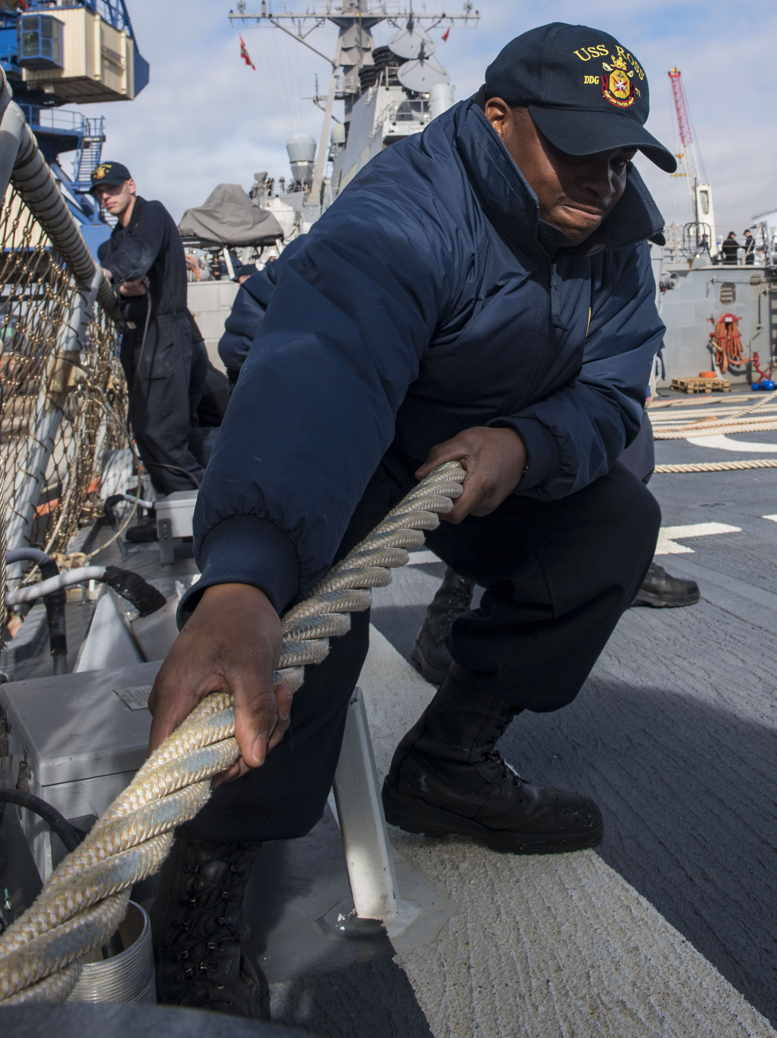 AGADIR, Morocco (Jan. 10, 2018) Fire Controlman (Aegis) 3rd Class Mark Bowman heaves a mooring line as the Arleigh Burke-class guided-missile destroyer USS Ross (DDG 71) pulls in to Agadir, Morocco, Jan. 10, 2018. Ross, forward-deployed to Rota, Spain, is on its sixth patrol in the U.S. 6th Fleet area of operations in support of regional allies and partners and U.S. national security interests in Europe and Africa. (U.S. Navy photo by Mass Communication Specialist 1st Class Kyle Steckler/Released)