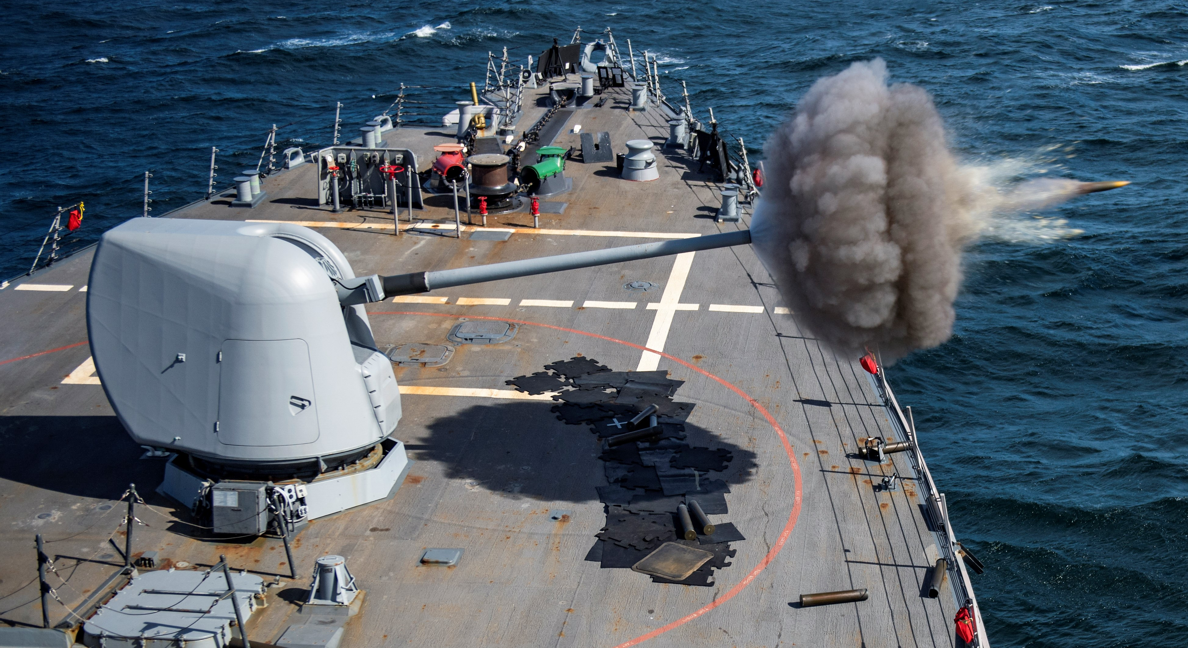 ATLANTIC OCEAN (Jan. 14, 2018) The Arleigh Burke-class guided-missile destroyer USS Ross (DDG 71) fires its 5-inch gun during a naval surface fire support exercise with the Royal Moroccan Navy as part of exercise African Sea Lion, Jan. 14, 2018. Among African Sea Lion's objectives is to test and evaluate US and Moroccan ability to conduct coordinated, combined naval surface fire support exercises on the Tan Tan firing range. Ross, forward-deployed to Rota, Spain, is on its sixth patrol in the U.S. 6th Fleet area of operations in support of regional allies and partners and U.S. national security interests in Europe and Africa. (U.S. Navy photo by Mass Communication Specialist 1st Class Kyle Steckler/Released)