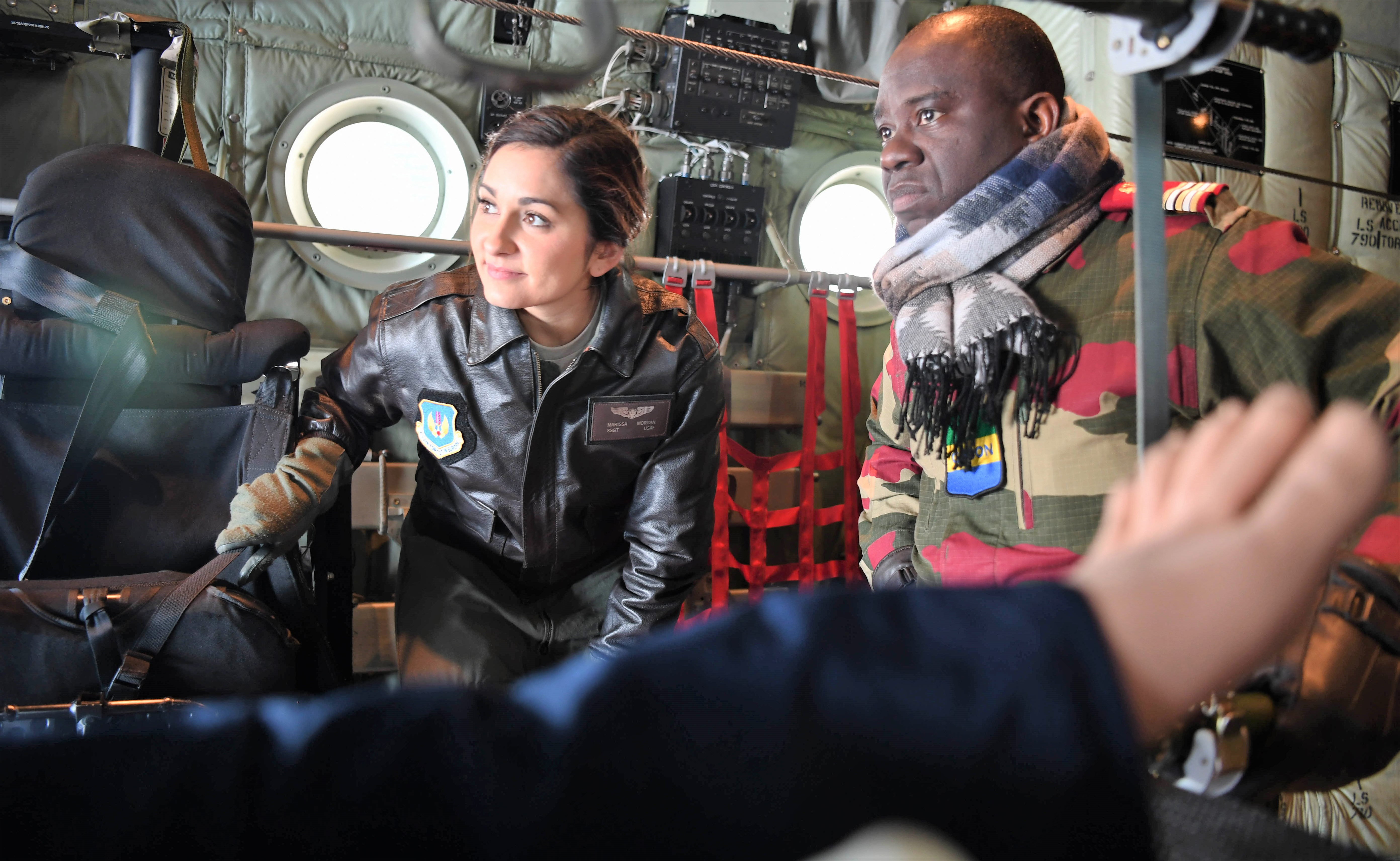U.S. Air Force Staff Sgt. Marissa Morgan, 86th Aeromedical Evacuation Squadron aeromedical technician, and Gabon air force Capt. Herve Batamio, prepare to load a patient on to a C-130J Super Hercules at Ramstein Air Base, Germany, Jan. 18, 2018. Thirteen countries gathered at Ramstein to exchange aeromedical tactics, techniques, and procedures to encourage working relationships between the nations during a week-long symposium. (U.S. Air Force photo by Tech. Sgt. Rachelle Coleman)