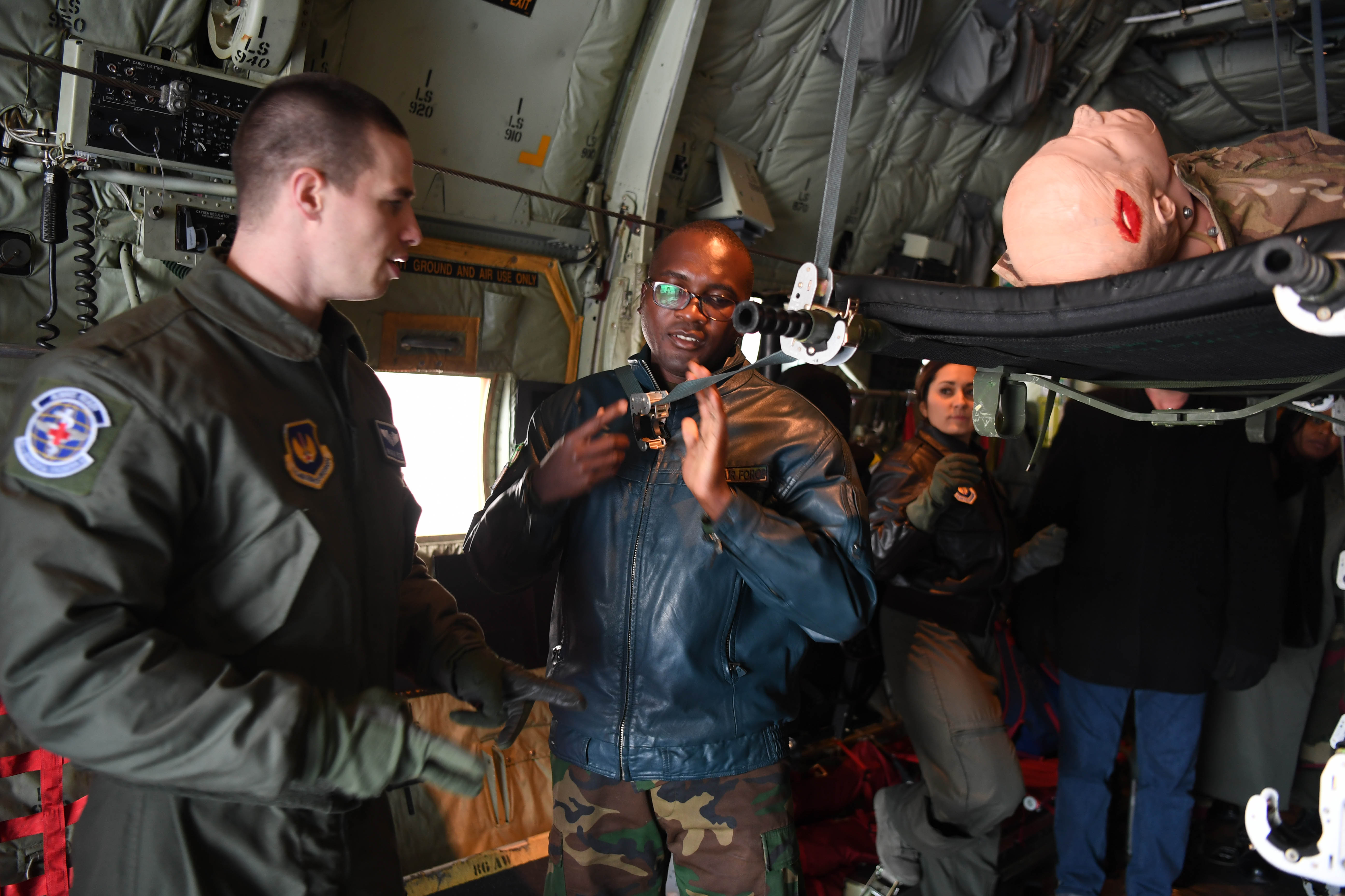 U.S. Air Force 1st Lt. Brian Potje, 86th Aeromedical Evacuation Squadron flight nurse, shows Zambian air force Maj. Nelson Lombe, how to secure a patient on a litter in a C-130J Super Hercules at Ramstein Air Base, Germany, Jan. 18, 2018. As part of the U.S. Air Forces Europe-Air Forces in Africa Partnership Flight Symposium aeromedical aircrews from 13 nations exchanged ideas and procedures with other nations to better understand capabilities and strategies used in medical airlift. (U.S. Air Force photo by Tech. Sgt. Rachelle Coleman)