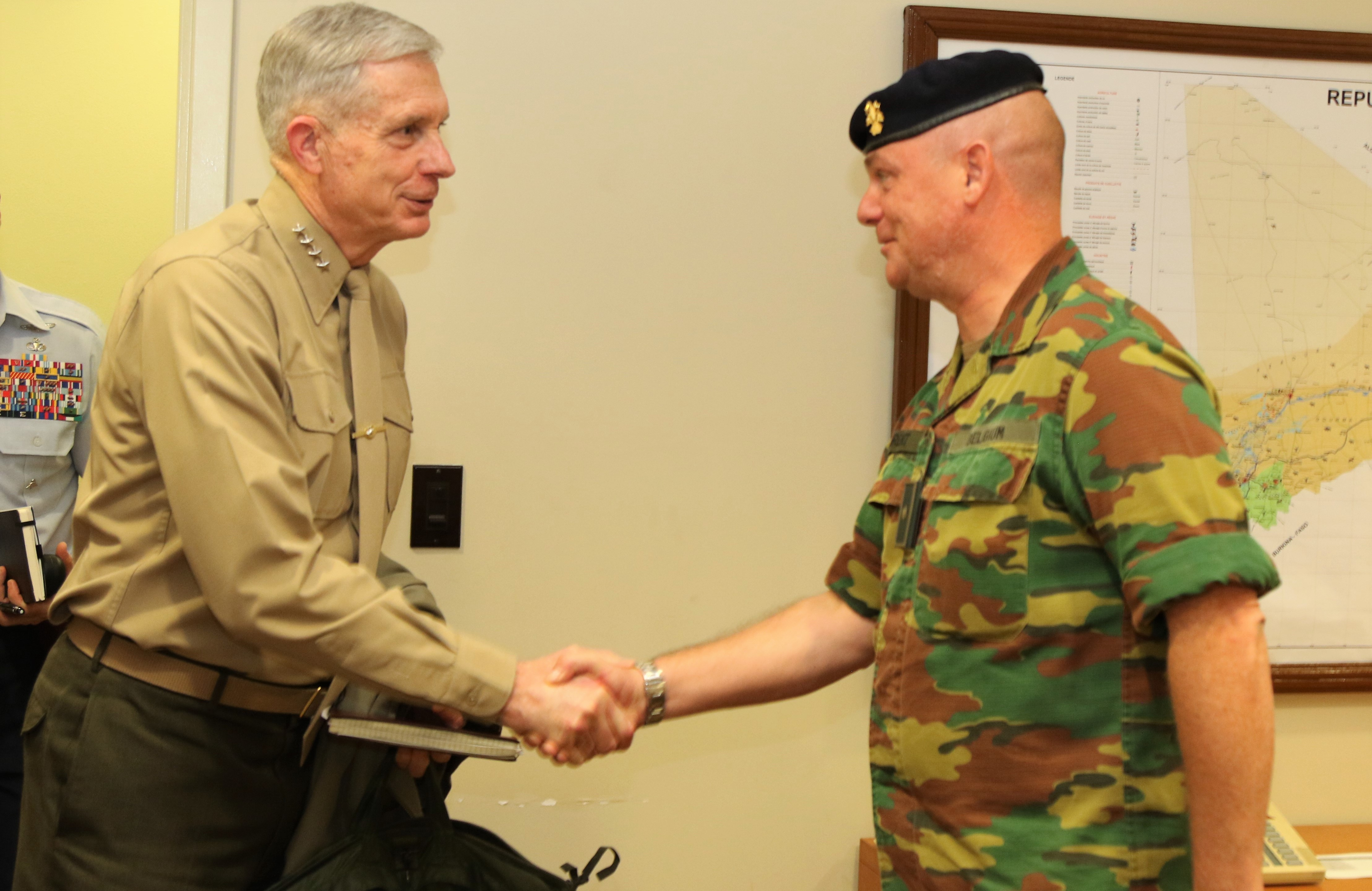 U.S. Marine Corps Gen. Thomas D. Waldhauser, commander, U.S. Africa Command, left, meets with Belgian Brig. Gen. Bart Laurent, commander, European Union Training Mission in Mali Jan 23, 2018 in Bamako, Mali. (U.S. AFRICOM photo by Nate Herring/Released)