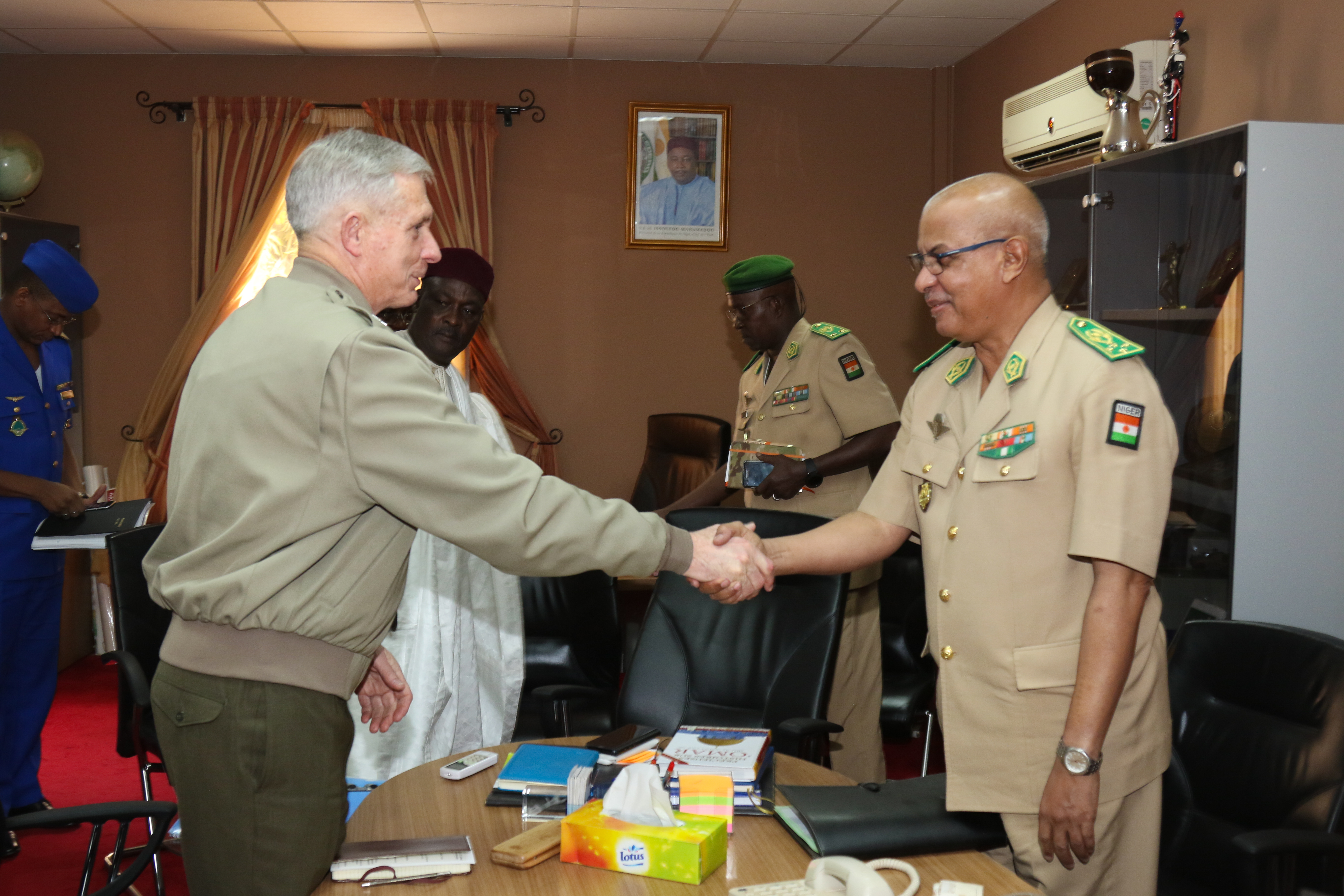 U.S. Marine Corps Gen. Thomas D. Waldhauser, commander, U.S. Africa Command, greets Lt. Gen. Ahmed Mohamed, Nigerien Chief of Defense, during a meeting Jan. 24, 2018 in Niamey, Niger.
