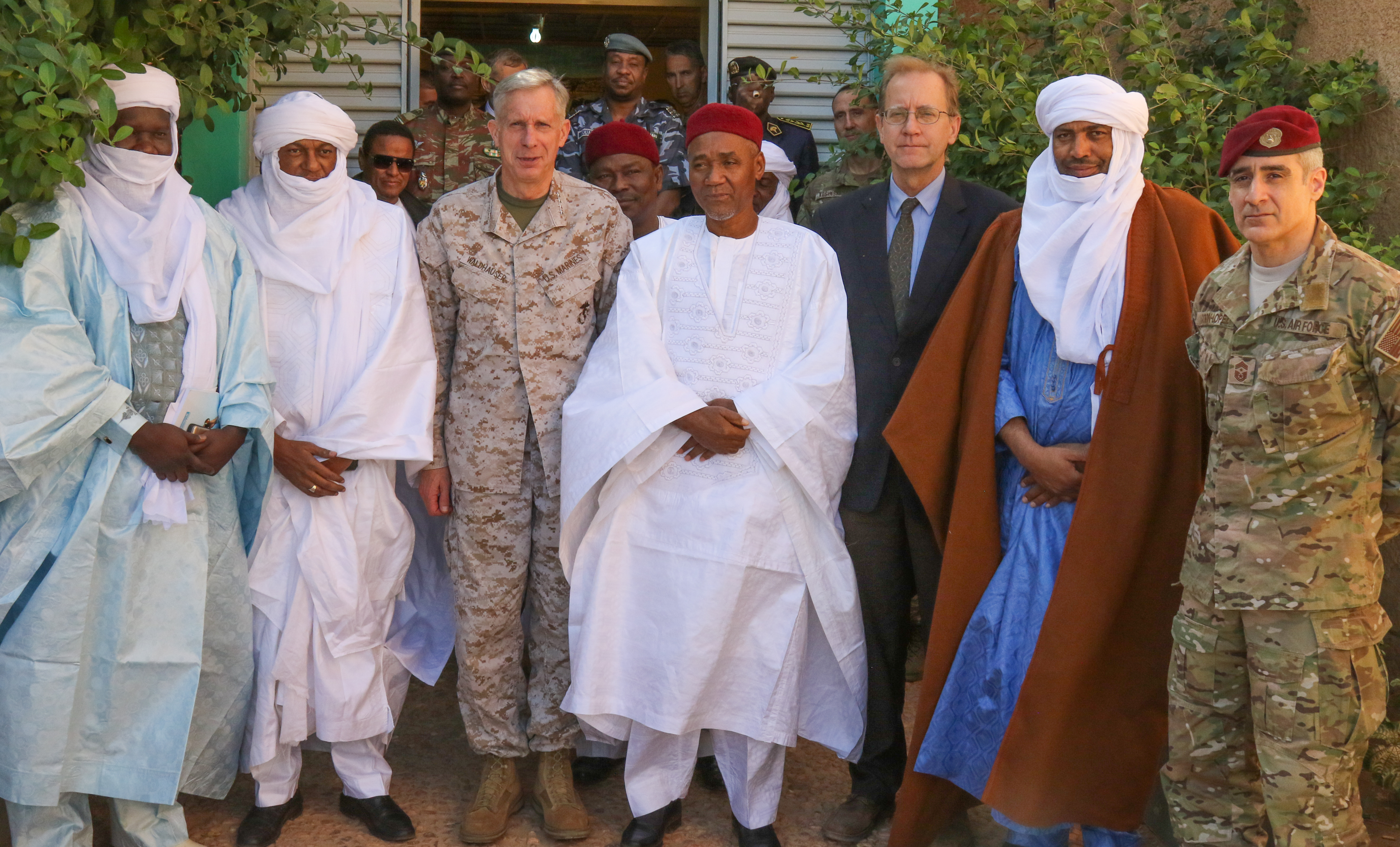 U.S. Marine Corps Gen. Thomas D. Waldhauser, commander, U.S. Africa Command, and U.S. Air Force Chief Master Sgt. Ramon Colon-Lopez, AFRICOM command senior enlisted leader, pose for a group photo with civic and government leaders from Agadez, Niger Jan. 25, 2018.