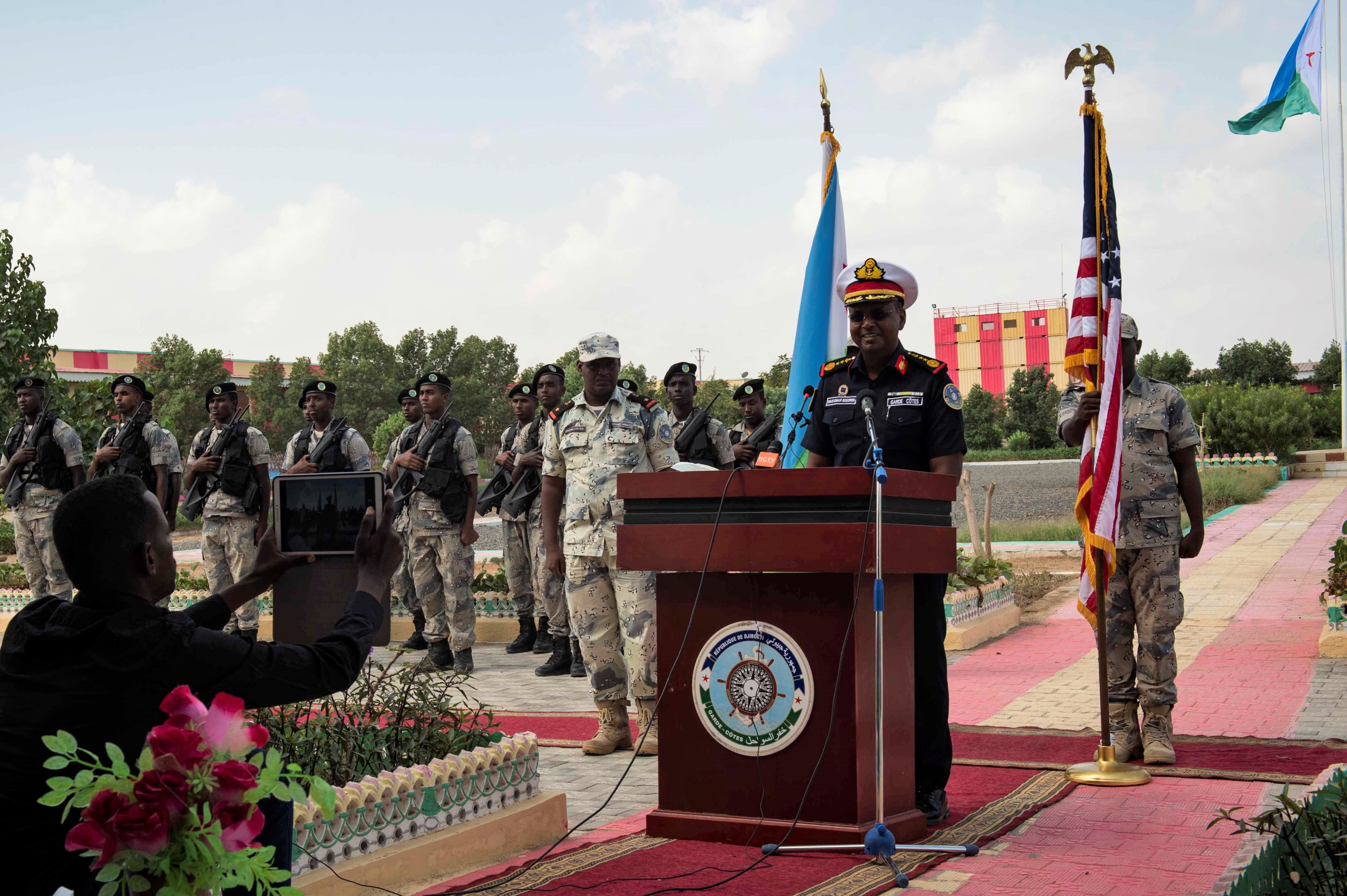 180131-N-KP948-204 DJIBOUTI, Djibouti (Jan. 31, 2018) Djiboutian Col. Was Omar Bogoreh, commander, Djiboutian Coast Guard, gives remarks during the opening ceremony for exercise Cutlass Express 2018 Jan. 31 in Djibouti, Djibouti. Cutlass Express is designed to improve regional cooperation, maritime domain awareness and information sharing practices to increase capabilities between the U.S., East African and Western Indian Ocean nations. (U.S. Navy photo by Mass Communication Specialist 2nd Class Alyssa Weeks / Released)