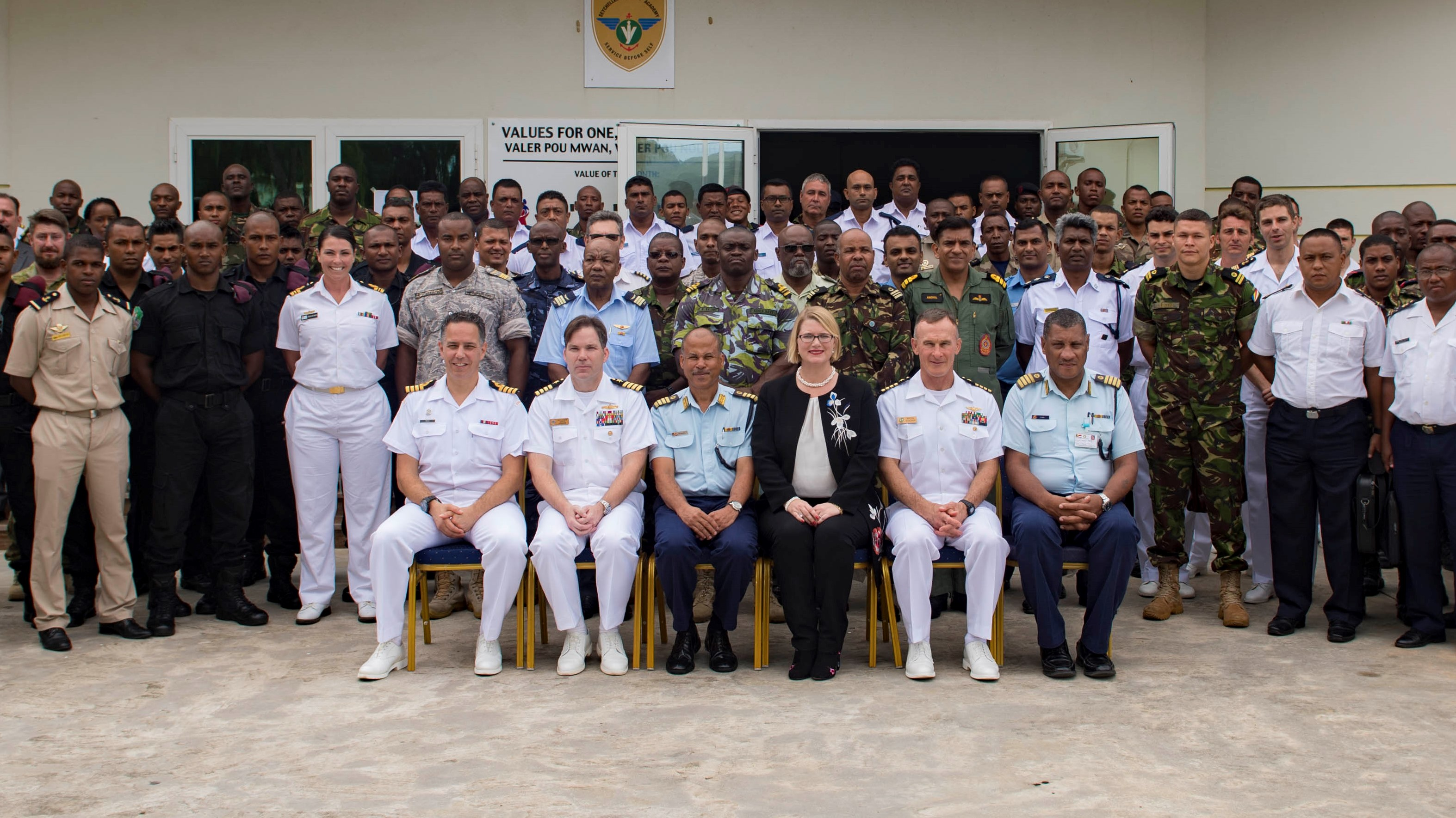 180131-N-JI086-114 VICTORIA, Seychelles (Jan. 31, 2018) Sailors from participating countries pose for a group photo after the opening ceremony of exercise Cutlass Express 2018 Jan. 31 in Victoria, Seychelles. Cutlass Express is designed to improve regional cooperation, maritime domain awareness and information sharing practices to increase capabilities of East African and Western Indian Ocean nations. (U.S. Navy photo by Mass Communication Specialist 3rd Class Ford Williams/Released)
