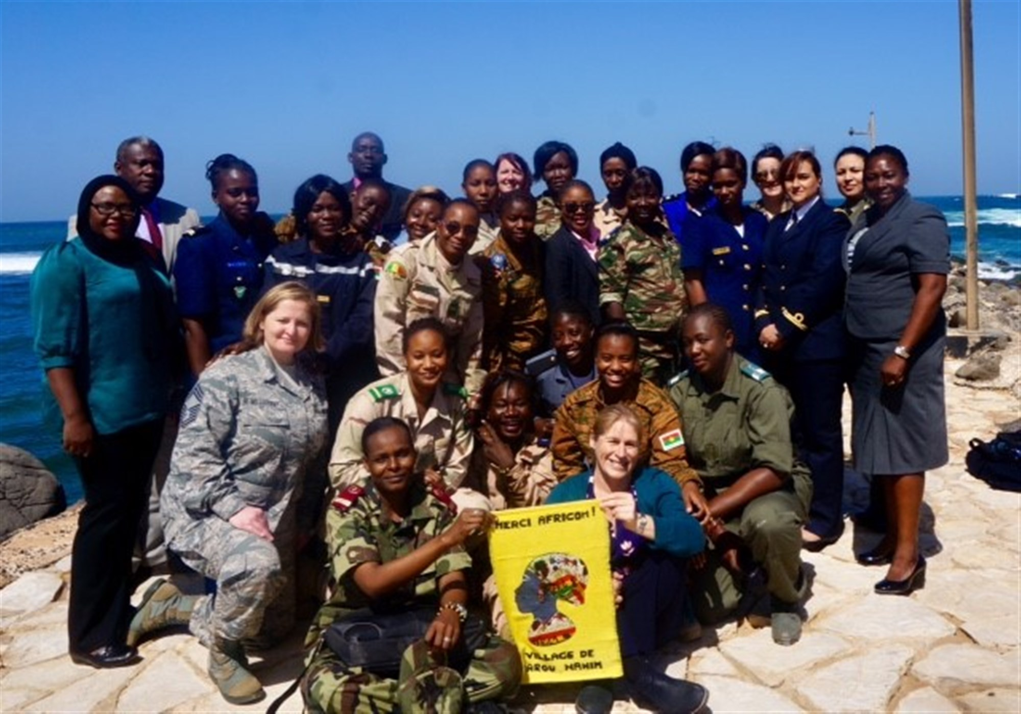 Students and instructors from the U.S. Africa Command's Intelligence Directorate (J2) regional all-female Military Intelligence Professionals Course pose for a group photo during a visit to a local village where they learned how females have made a difference in their community.