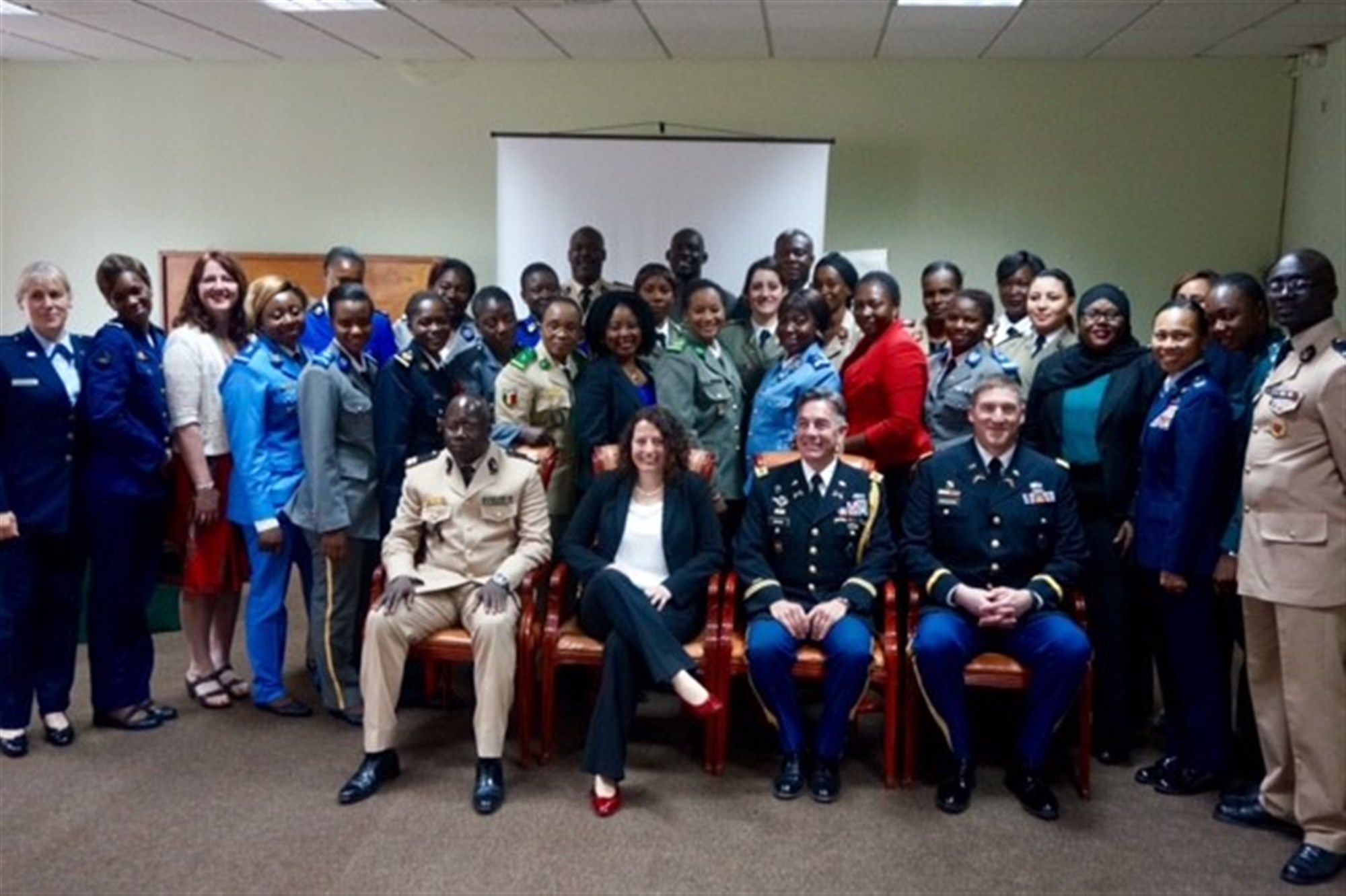 Students and instructors from the U.S. Africa Command's Intelligence Directorate (J2) regional all-female Military Intelligence Professionals Course pose for a group photo during the course graduation.