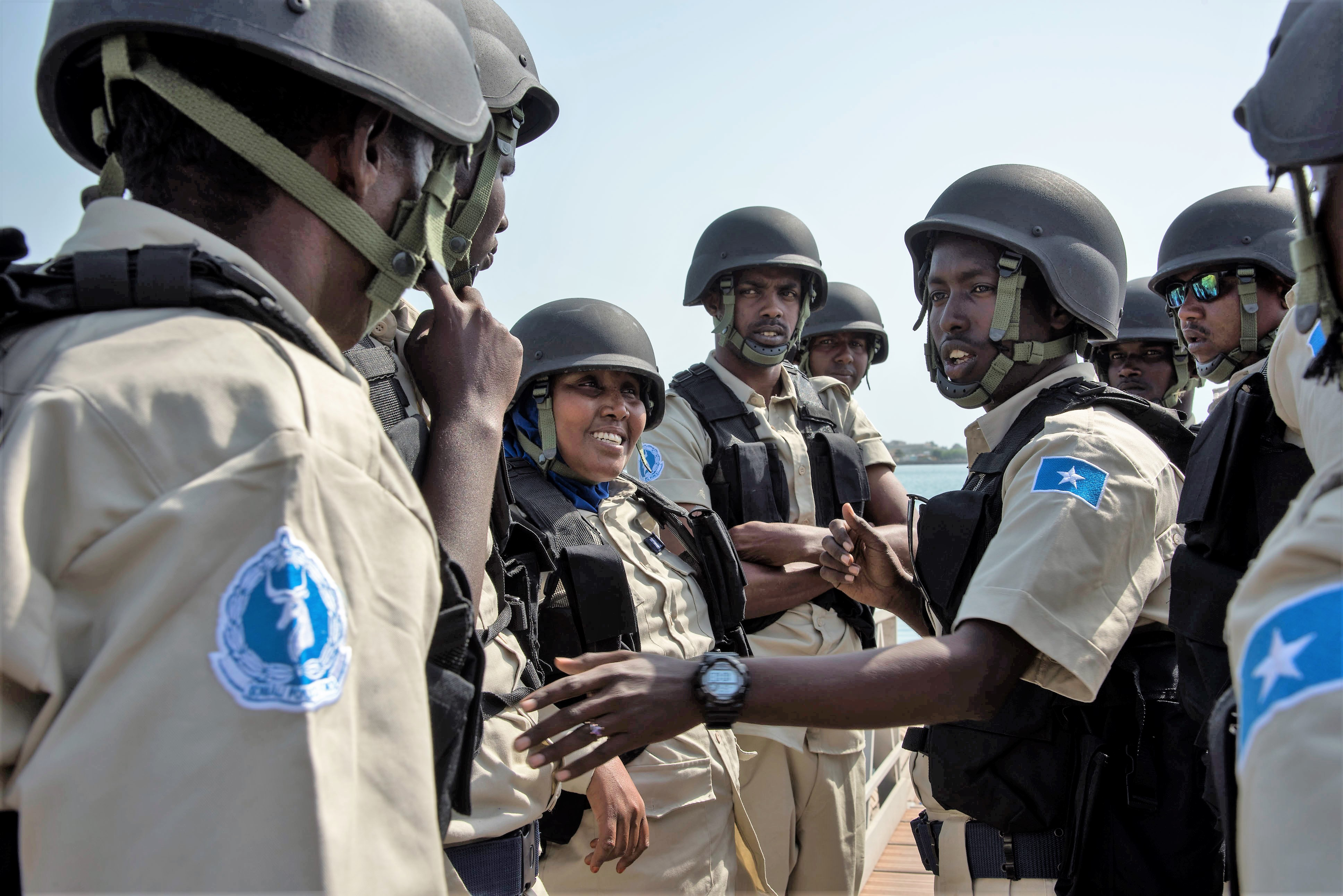 Somali maritime police talk together before running through a visit, board, search and seizure drill (VBSS) during exercise Cutlass Express 2018 in the Port of Djibouti Feb. 5, 2018. Cutlass Express is designed to improve cooperation, maritime domain awareness and information sharing practices to increase capabilities between the U.S., East African and Western Indian Ocean nations. (U.S. Air National Guard photo by SSgt Allyson Manners)