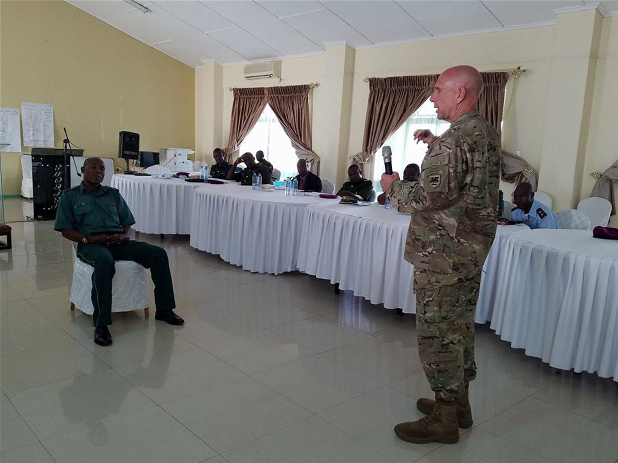 Warrant Officer Class 1 Wirgan Mwape from the Zambian Defense Force, left, and Chaplain (Col.) David Lile, the U.S. Army Africa command chaplain, right, participate in a suicide prevention training exercise during a seminar attended by USARAF and Zambian Defense Force chaplains in Lusaka, Zambia, Jan. 23-25, 2018. During the seminar, the chaplains discussed peacekeeping operations deployment cycle support and the emotional and spiritual stresses of combat on the African continent. (Courtesy photo)