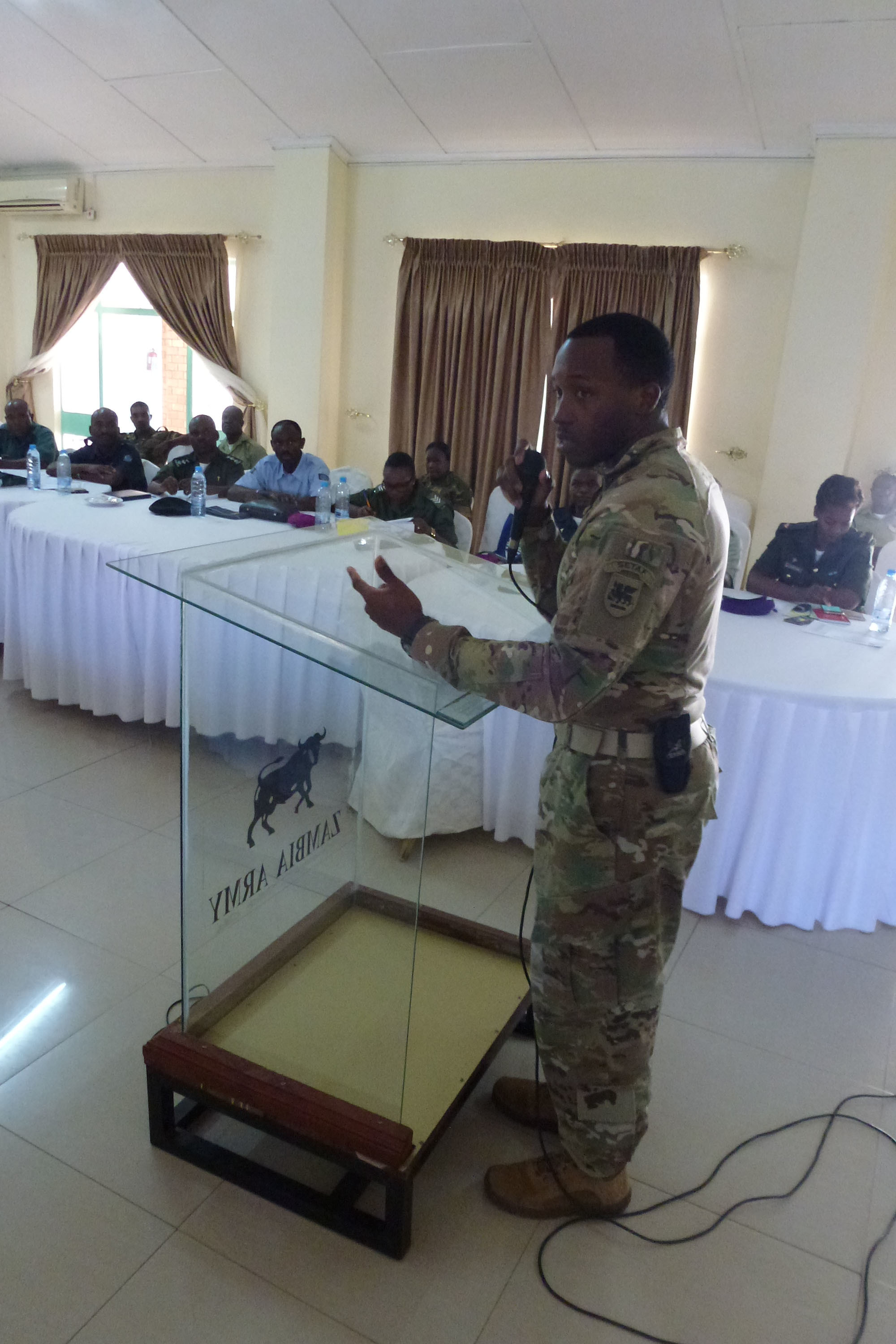 Sgt. 1st Class George L. Butler, the U.S. Army Africa senior religious affairs noncommissioned officer in charge, speaks during a seminar attended by USARAF and Zambian Defense Force chaplains in Lusaka, Zambia, Jan. 23-25, 2018. During the seminar, the chaplains discussed peacekeeping operations deployment cycle support and the emotional and spiritual stresses of combat on the African continent. (U.S. Army photo/Chaplain (Col.) David Lile)