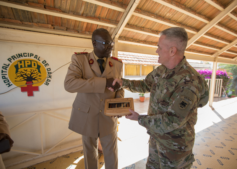 U.S. Army Col. Marvin Emerson, U.S. Army Africa deputy command surgeon, recognizes Senegalese Col. Abdou Rajack Ndiaye, Feb. 22, 2018, for his assistance and coordination during MEDRETE 18-1, at Hopital Principal De Dakar, Dakar, Senegal. MEDRETE is a combined effort between the Senegalese government, U.S. Army Africa, and the Vermont National Guard. MEDRETE 18-1 is the first in a series of medical readiness training exercises that U.S. Army Africa is scheduled to facilitate within various countries in Africa, and serves as an opportunity for the partnered militaries to hone and strengthen their general surgery and trauma skills while reinforcing the partnership between the countries. The mutually beneficial exercise brings together Senegalese military and U.S. Army medical professionals to foster cooperation while conducting medical specific tasks. (U.S. Army photo by Sgt. Micah Merrill)