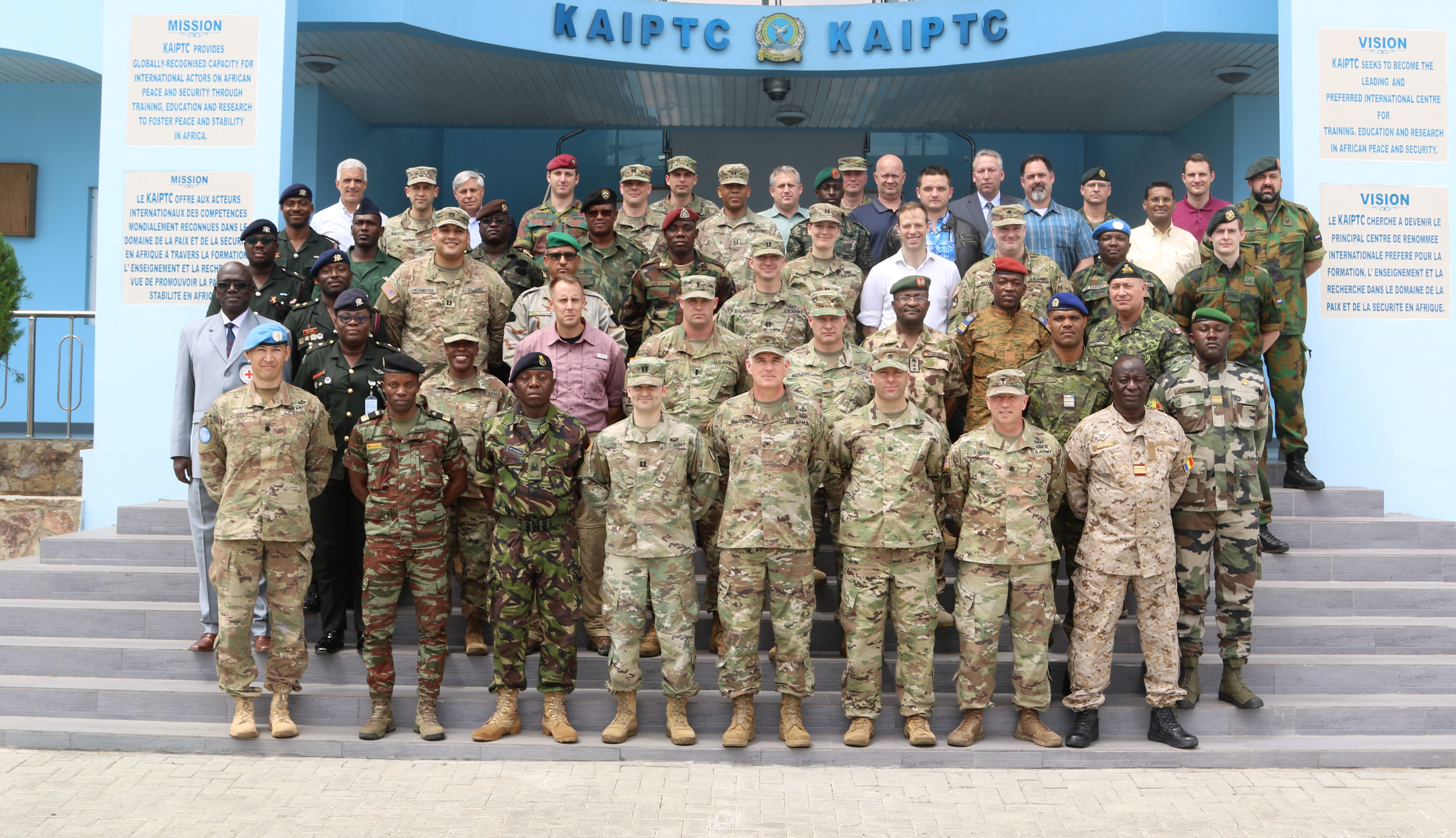 Exercise planners from various nations pose for a photograph during the United Accord 2018 Main Planning Event at the Kofi Annan International Peacekeeping Training Center, Accra, Ghana March 1, 2018. The combined-joint planning event hosted by the GAF included delegates from 5 Western partner nations and 10 African partner nations with a wide range of experience in regional peacekeeping operations, the basis for the accord series of exercises. (Photo By Sgt. 1st Class Chris Bridson)