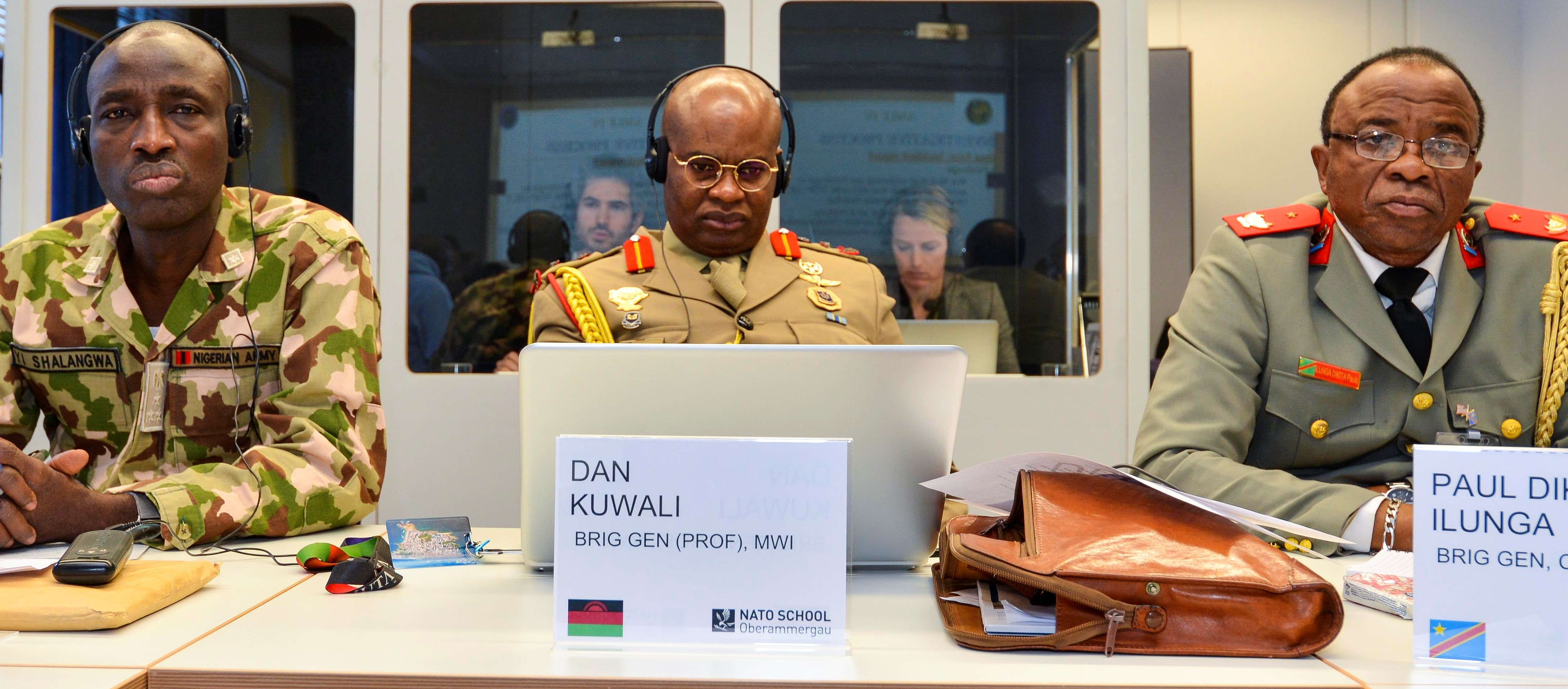 Brig. Gen. Yusuf Ibrahim Shalangwa of Nigeria, Brig. Gen. Dan Kuwali of Malawi and Brig. Gen. Paul Dikita Ilunga of the Democratic Republic of Congo listen to a presentation during the U.S. AFRICOM hosted annual Africa Military Law Forum, Oberammergau in Germany, March 1, 2018. (Photo by Cpl. Victor Leonard, NATO School Public Affairs/Released)