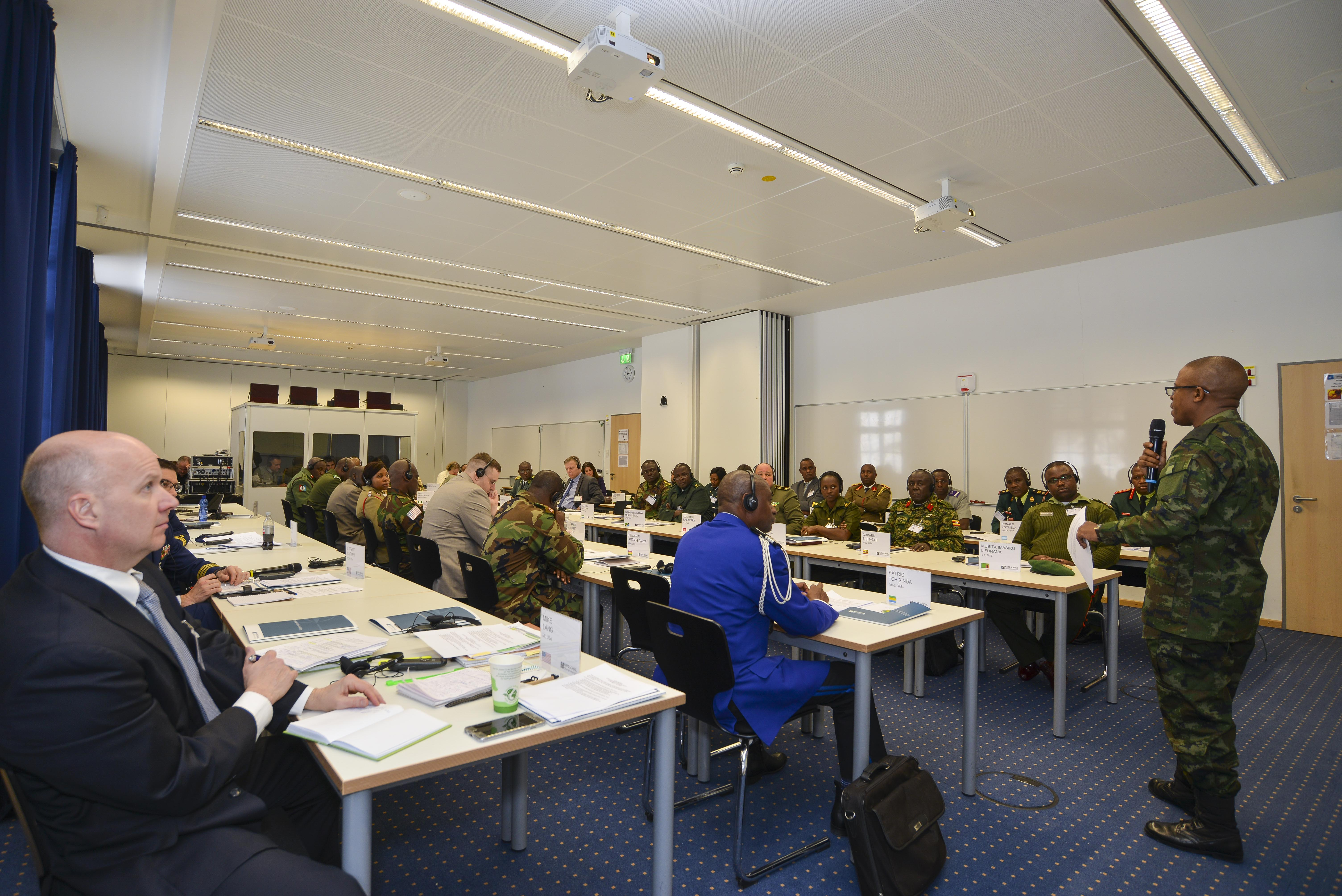 Rwandan military prosecutor Lt. Col. Pacifique Kabanda (standing) describes the current challenges in supporting investigations, Oberammergau, Germany, March 1, 2018. (Photo by Cpl. Victor Leonard, NATO School Public Affairs/Released)