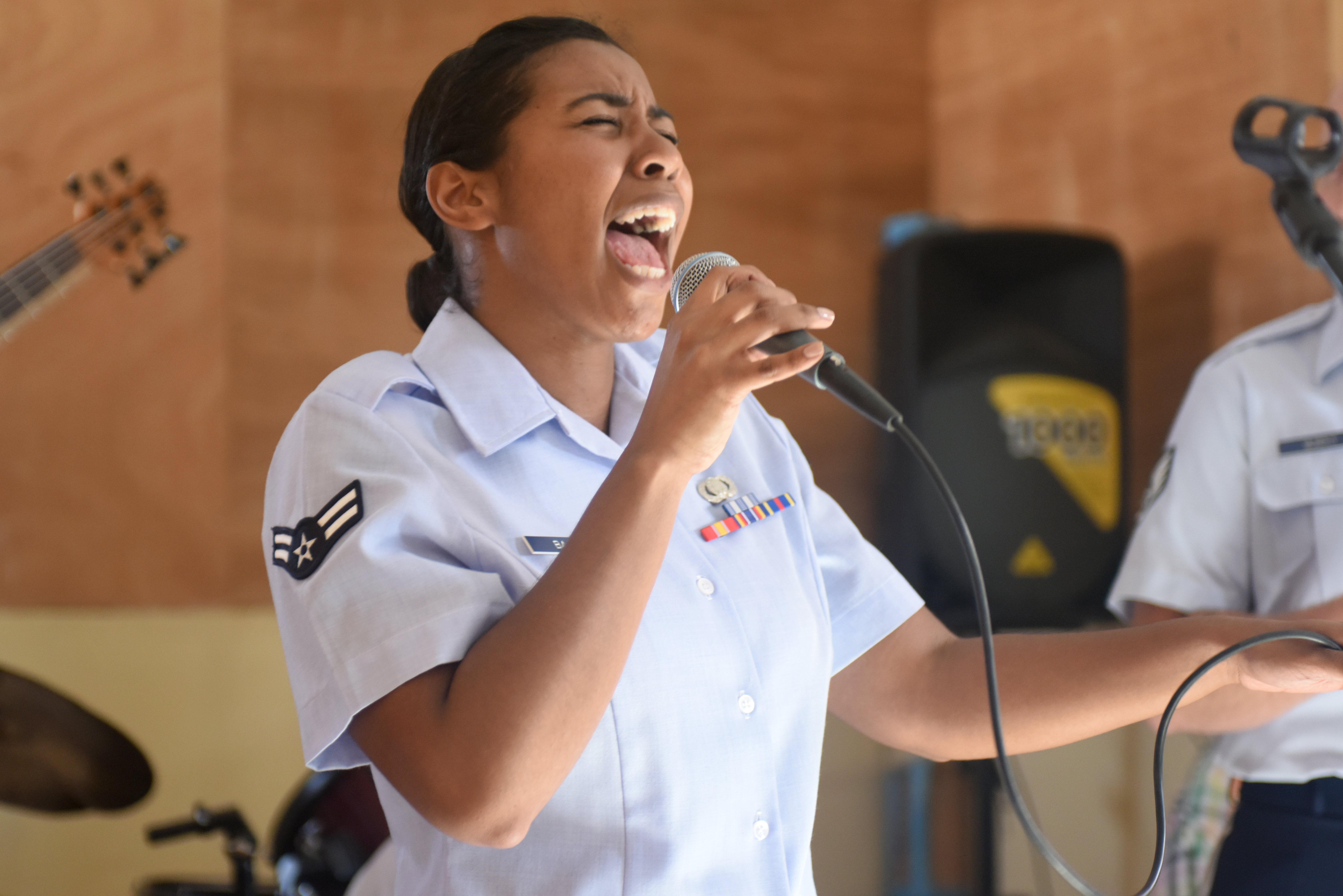 Airman 1st Class Sierra Bailey, U.S. Air Forces in Europe Band vocalist, sings for students of the National School of the Arts in Dakar, Senegal, March 21, 2018. The USAFE Band is in Dakar to support African Partnership Flight Senegal, a military-to-military event focusing on improving professional military aviation knowledge and skills. (U.S. Air Force photo by Airman 1st Class Eli Chevalier)