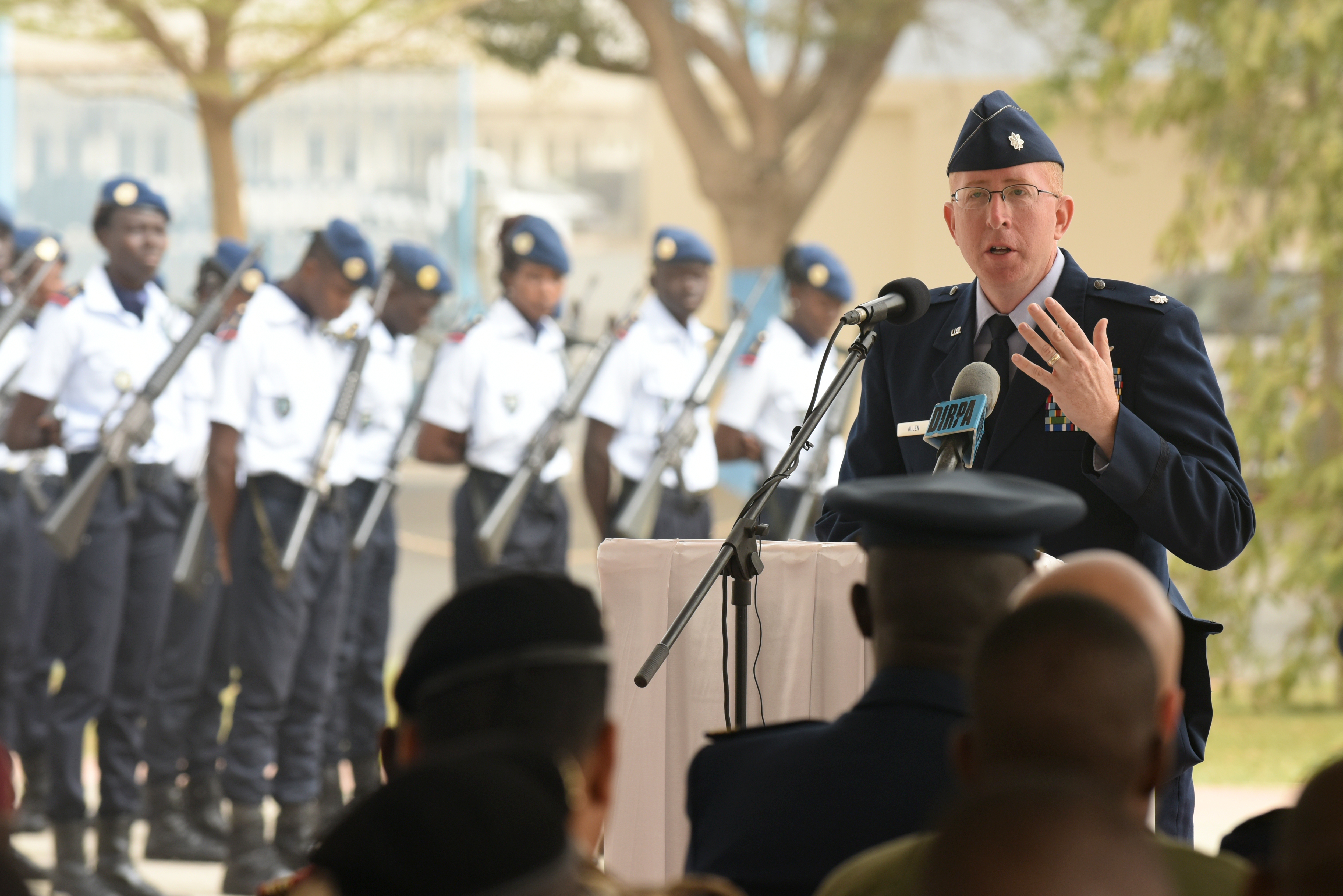 U.S. Air Force Lt. Col. Andrew Allen, chief of global health engagements branch, U.S. Air Forces in Europe and Air Forces Africa, speaks during the closing ceremony of African Partnership Flight Senegal at Captain Andalla Cissé Air Base, Senegal, March 23, 2018. The purpose of APF Senegal is to conduct multilateral, military-to-military engagements and security assistance with African air forces. (U.S. Air Force photo by Airman 1st Class Eli Chevalier)