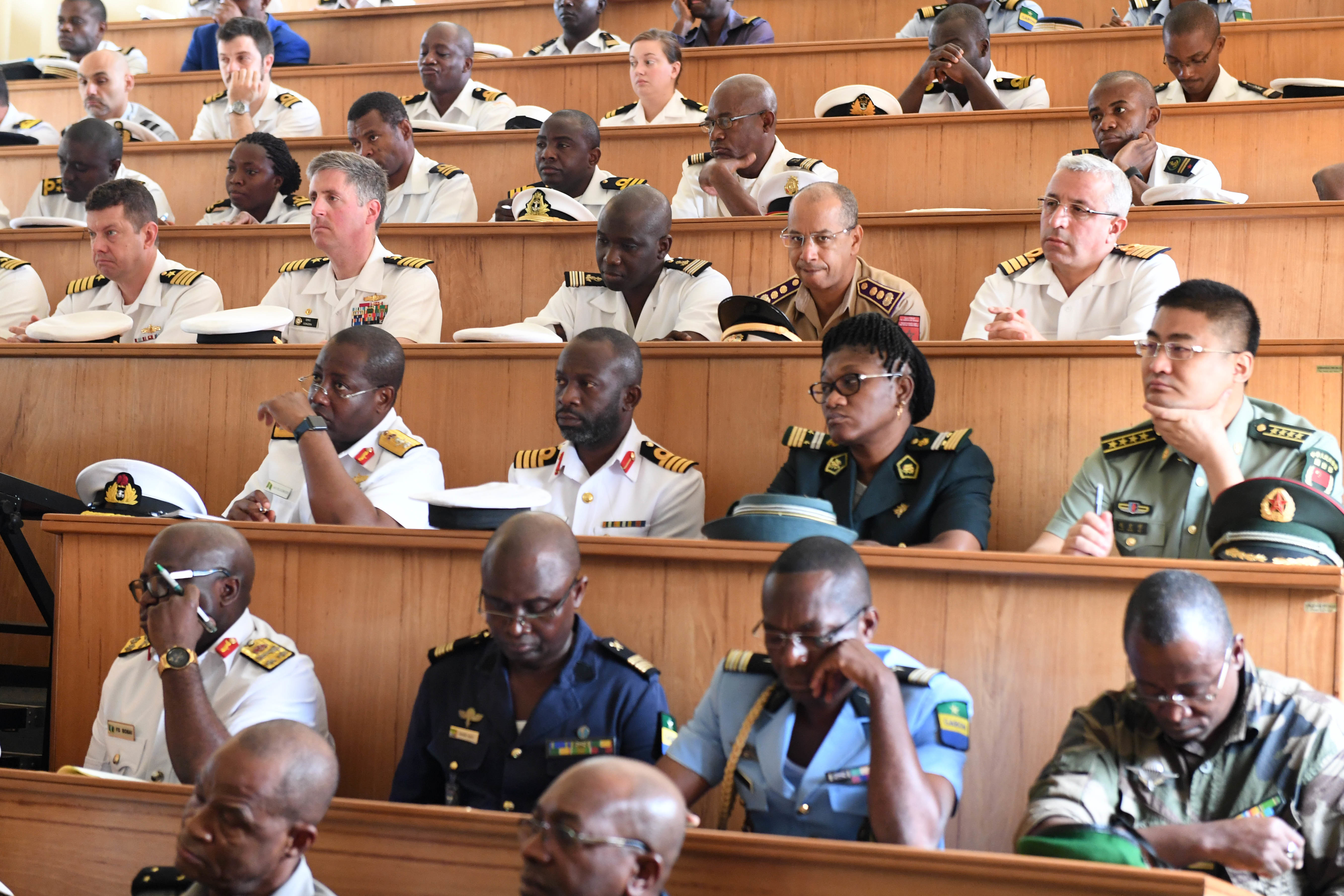 180321-N-XT273-053 LIBREVILLE, Gabon (March 21, 2018) Participating African forces and international partners attend the exercise Obangame Express 2018 opening ceremony in Libreville, Gabon, March 21, 2018. Obangame Express 2018, which is sponsored by U.S. Africa Command (AFRICOM), is designed to improve regional cooperation, maritime domain awareness (MDA), information-sharing practices, and tactical interdiction expertise to enhance the collective capabilities of Gulf of Guinea and West African nations to counter sea-based illicit activity. (U.S. Navy photo by Mass Communication Specialist 1st Class Justin Stumberg)