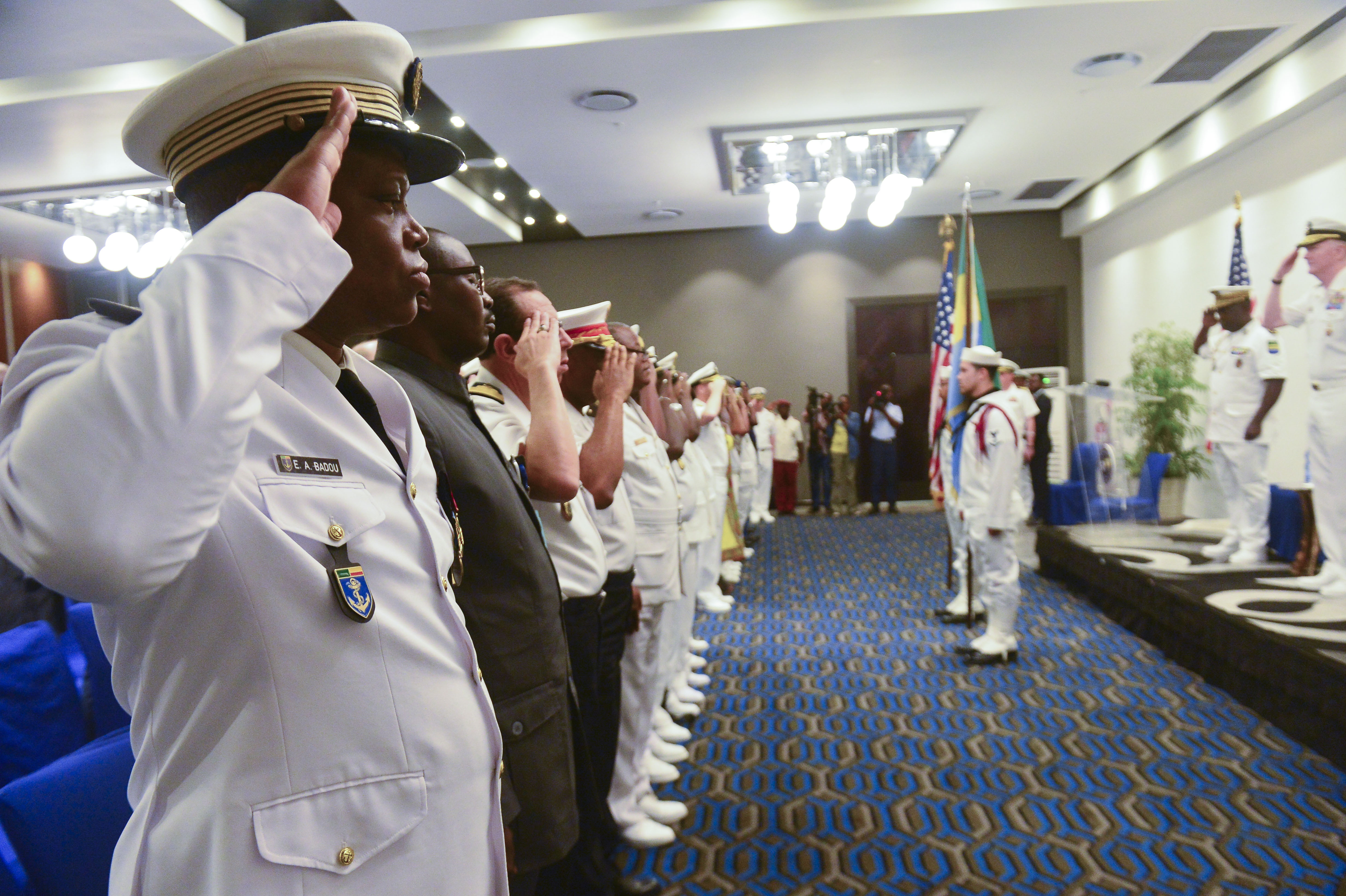 180329-N-QR145-271 LIBREVILLE, Gabon (March 29, 2018) Blue Ridge-class command and control ship USS Mount Whitney's (LCC 20) color guard team presents the colors during the exercise Obangame Express 2018 closing ceremonies in Libreville, Gabon, March 29. Exercise Obangame Express 2018, which is sponsored by U.S. Africa Command (AFRICOM), is designed to improve regional cooperation, maritime domain awareness (MDA), information-sharing practices, and tactical interdiction expertise to enhance the collective capabilities of Gulf of Guinea and West African nations to counter sea-based illicit activity. (U.S. Navy photo by Mass Communication Specialist 3rd Class Krystina Coffey/Released)