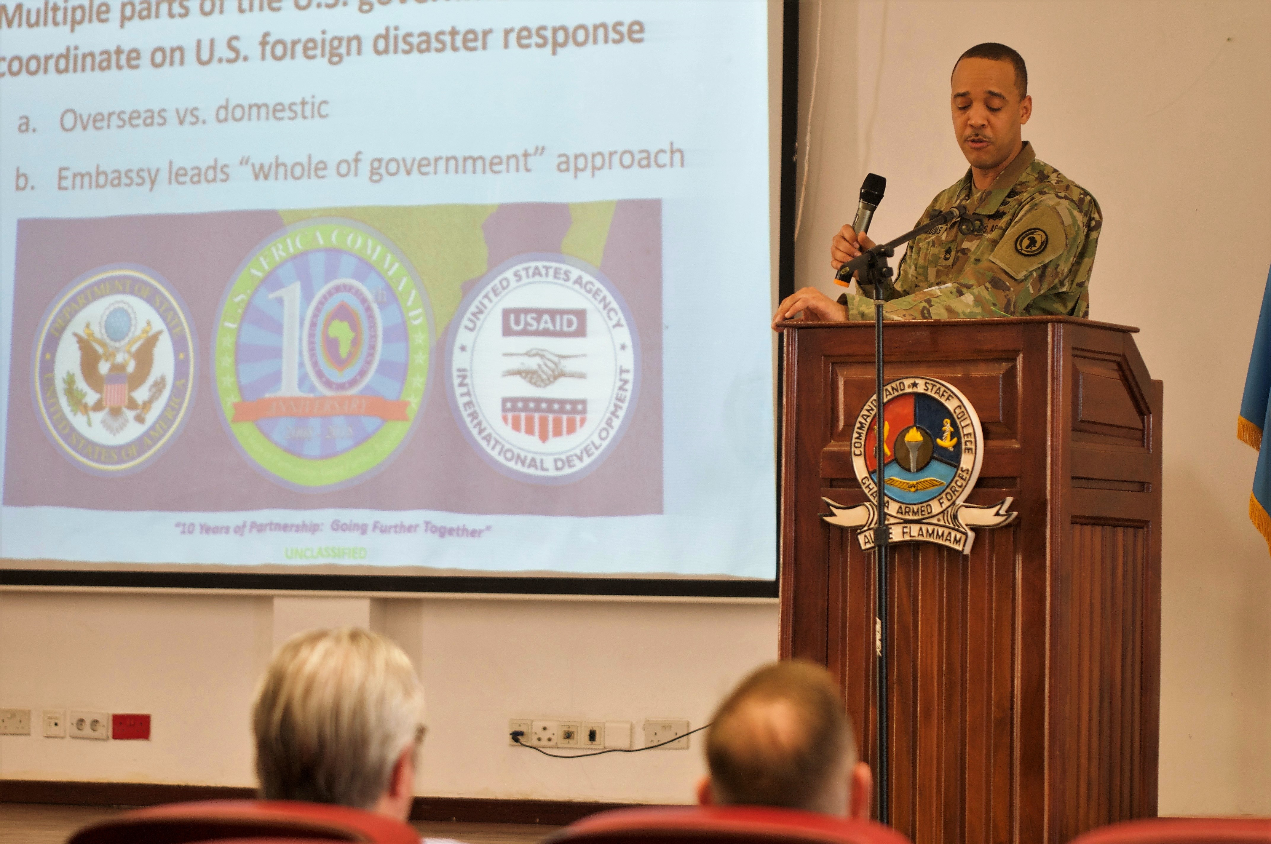 U.S. Africa Command J5 Civil Affairs NCOIC Sgt. First Class S Rahsann Soumas speaks on civilian-military coordination. AFRICOM and Ghana's National Disaster Management Organization (NADMO) co-sponsored a natural disaster response forum in Accra.  The event brought together experts in disaster management from multiple organizations in Ghana and the U.S. and was conducted at the Ghana Armed Forces Command and Staff College, March 12-15, 2018. (U.S. AFRICOM photo)