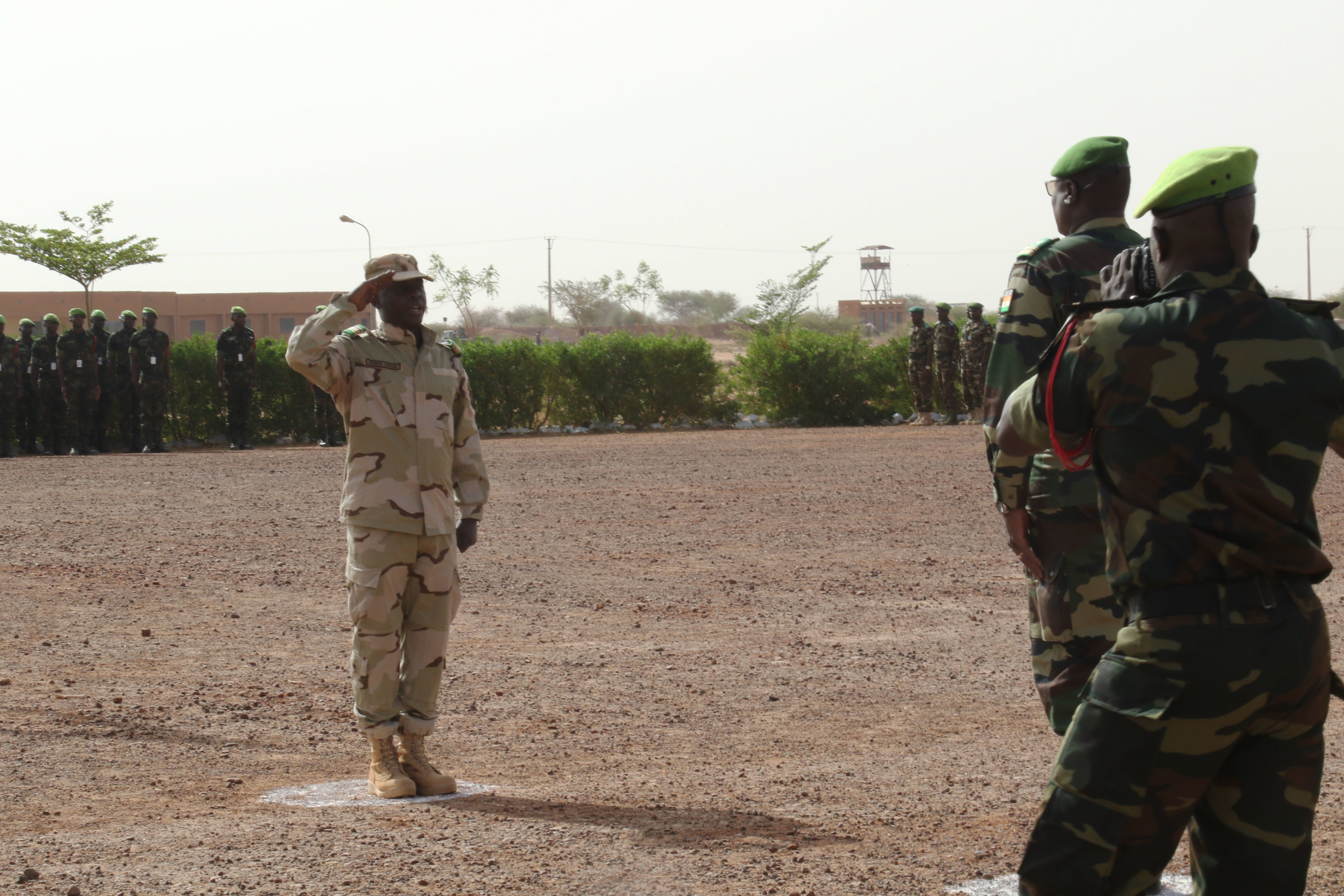 TAHOUA, Niger - Col. Mohamed Toumba, Zone 4 Commander, Forces Armees Nigeriennes, or FAN, inspects international service members participating in Flintlock 2018 in Tahoua, Niger, April 11, 2018. Flintlock 2018, hosted by Niger, with key outstations at Burkina Faso and Senegal, is designed to strengthen the ability of key partner nations in the region to counter violent extremist organizations, protect their borders, and provide security for their people. (U.S. Army photo by Staff Sgt. Kulani Lakanaria/RELEASED)