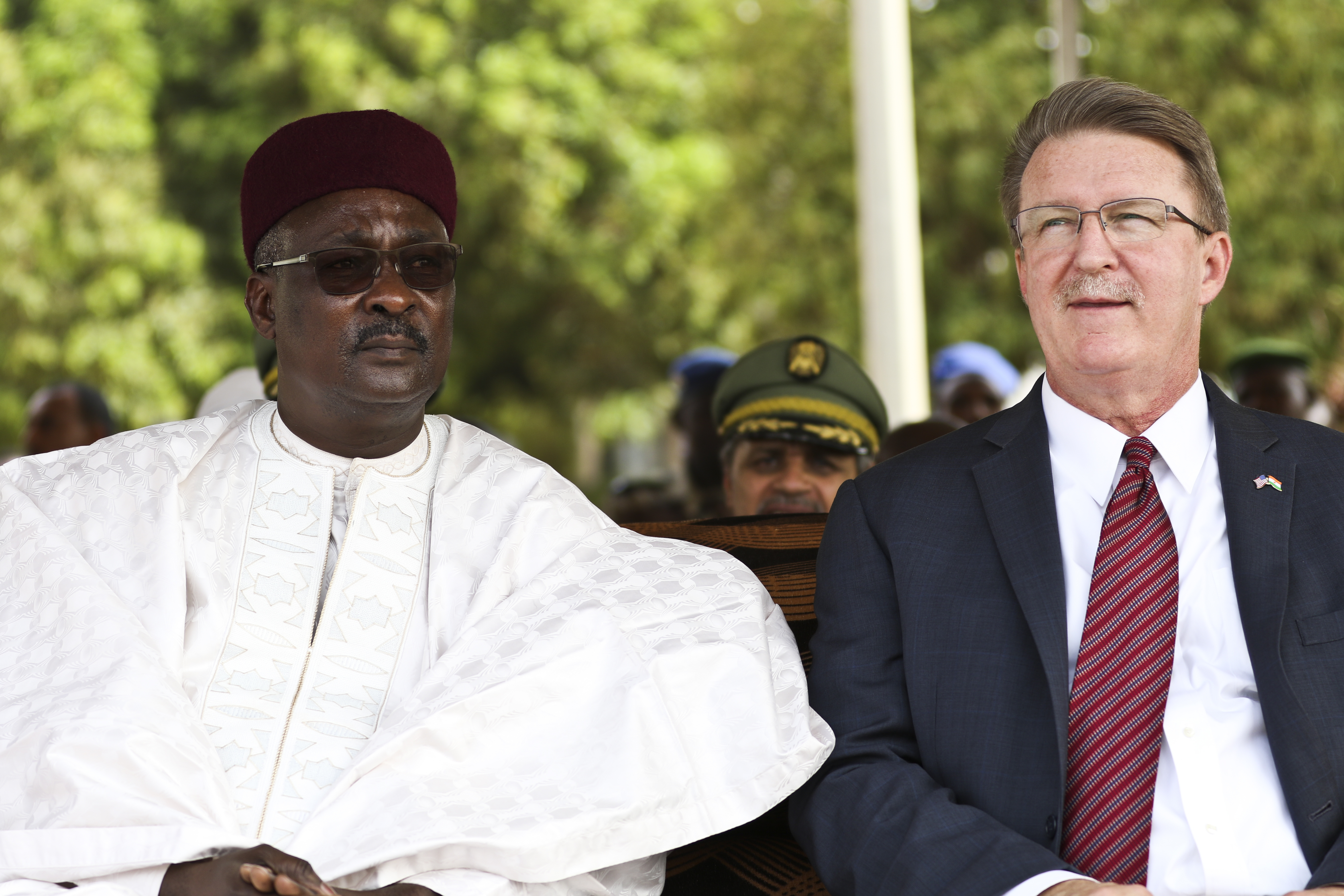 NIAMEY, Niger – Moutari Kalla, Nigerien Minister of Defense, and Amb. Eric Whitaker, U.S. Ambassador to Niger, observe the opening ceremony of Flintlock 2018 in Niamey, Niger, April 11, 2018. Flintlock is an annual, African-led, integrated military and law enforcement exercise that has strengthened key partner nation forces throughout North and West Africa as well as western Special Operations Forces since 2005. (U.S. Army Photo by Sgt. Heather Doppke/79th Theater Sustainment Command)