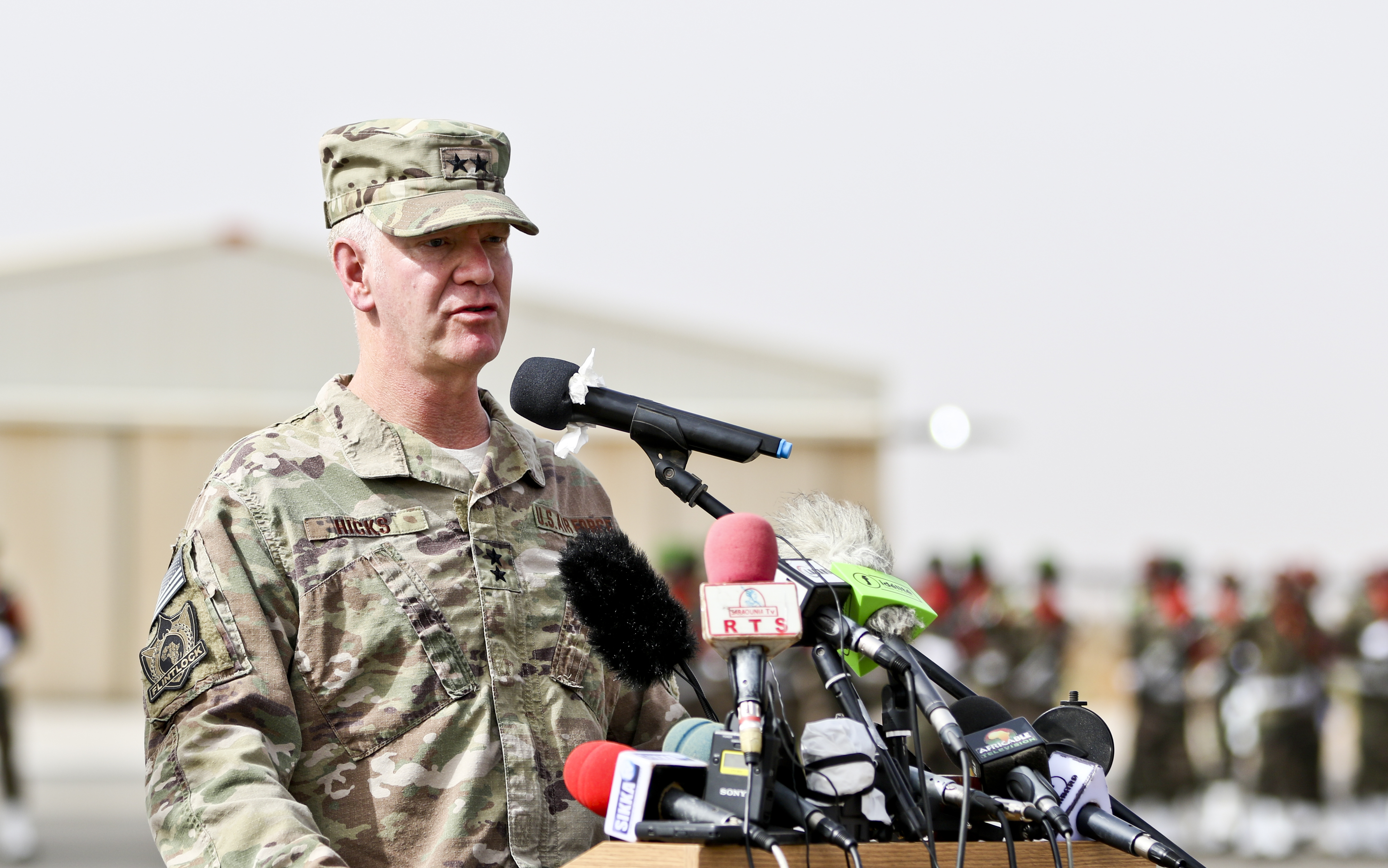 NIAMEY, Niger – Maj. Gen. Marcus Hicks, commander, Special Operations Command Africa, gives remarks during the opening ceremony of Flintlock 2018 in Niamey, Niger, April 11, 2018. Flintlock, hosted by Niger, with key outstations at Burkina Faso and Senegal, is designed to strengthen the ability of key partner nations in the region to counter violent extremist organizations, protect their borders, and provide security for their people. (U.S. Army Photo by Sgt. Heather Doppke/79th Theater Sustainment Command)