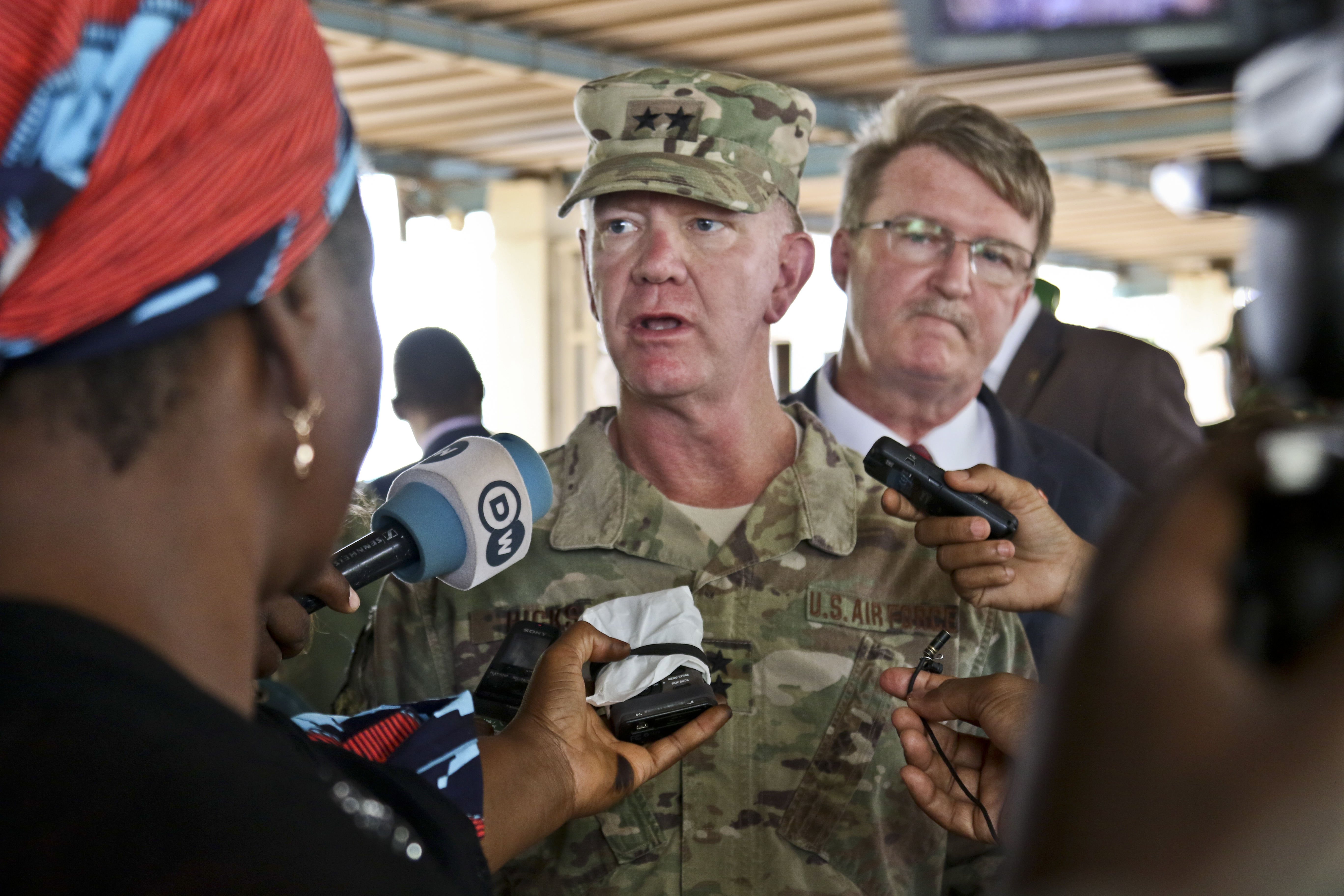 NIAMEY, Niger – U.S. Air Force Maj. Gen. Marcus Hicks, commander, Special Operations Command Africa, is interviewed by local media after the opening ceremony of Flintlock 2018 in Niamey, Niger, April 11, 2018. Flintlock, hosted by Niger, with key outstations at Burkina Faso and Senegal, is designed to strengthen the ability of key partner nations in the region to counter violent extremist organizations, protect their borders, and provide security for their people. (U.S. Army Photo by Sgt. Heather Doppke/79th Theater Sustainment Command)