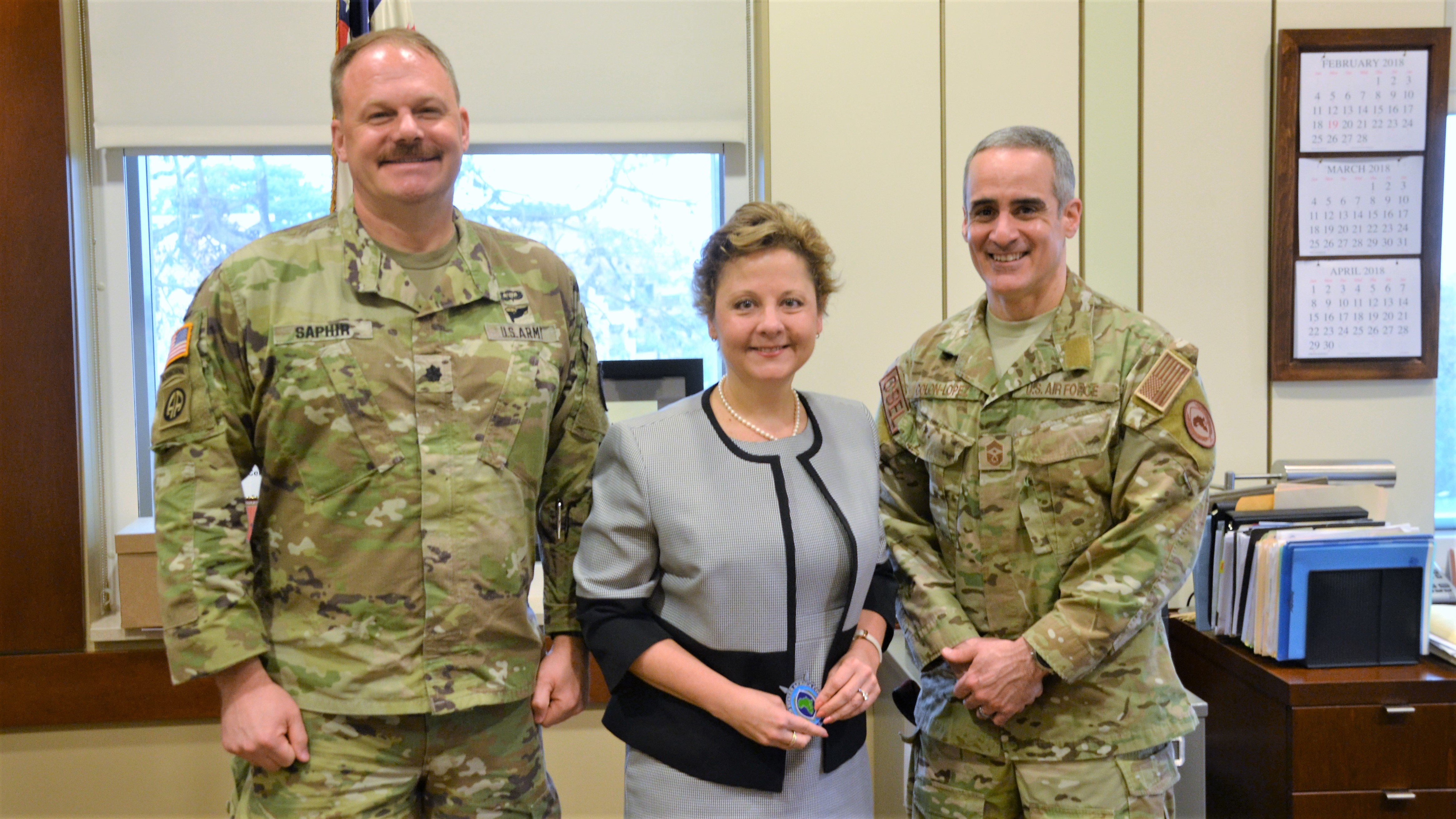 "Lt. Col. Marc Saphir, U.S. Senior Defense Official/Defense Attaché, U.S. Ambassador to Liberia Christine Elder, and U.S. Africa Command senior enlisted advisor, Chief Master Sgt. Ramon ""CZ"" Colon-Lopez, pose for a photo, during a visit to the U.S. Embassy there, April 2, 2018. The engagement was a part of a site to Liberia to meet with Liberia's military leadership in order to foster partnership between AFRICOM and the Armed Forces of Liberia, following the close of the United Nations Peacekeeping Mission in Liberia, after nearly 15 years in operation. (Photo by Army Staff Sgt. Grady Jones, AFRICOM Public Affairs)"