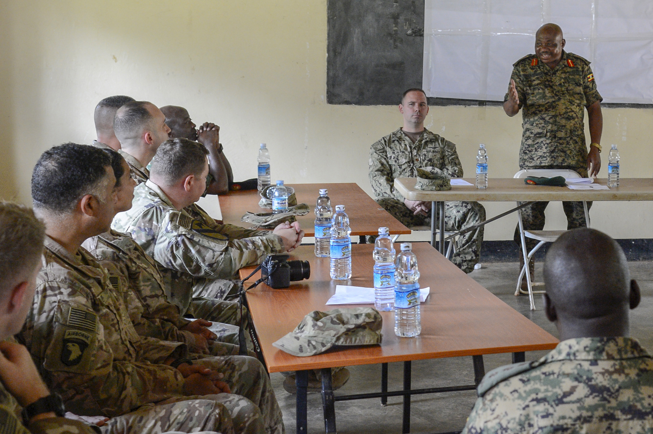 Uganda People's Defense Force (UPDF) Brig. Gen. Jack Backasumba, Camp Singo Commandant, thanks U.S. Army Soldiers during the graduation ceremony for a 10-week civil affairs operations course provided by the 404th Civil Affairs Battalion, at Camp Singo, Uganda, April 13, 2018. The civil affairs course is designed to enhance the UPDF's capability and capacity to support its enduring African Union peacekeeping force and African Union Mission in Somalia mandates through civil military cooperation. (U.S. Navy Photo by Mass Communication Specialist 2nd Class Timothy M. Ahearn)