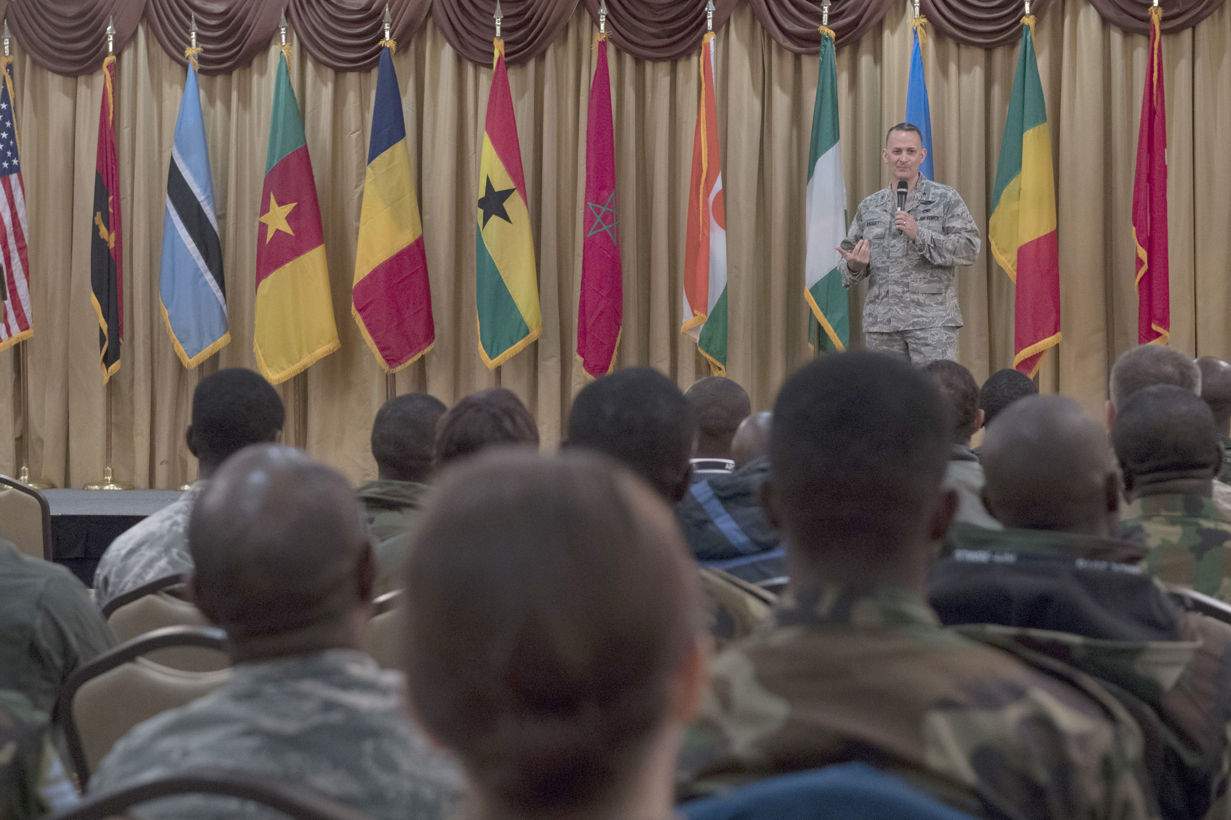 Brig. Gen. William Knight, U.S. Air Force Expeditionary Center vice commander, speaks during the opening ceremony of the African Partnership Flight at Joint Base McGuire-Dix-Lakehurst, N.J., April 16, 2018. Thirteen African countries participated in the week-long engagement. (U.S. Air Force photo by Tech. Sgt. Gustavo Gonzalez)