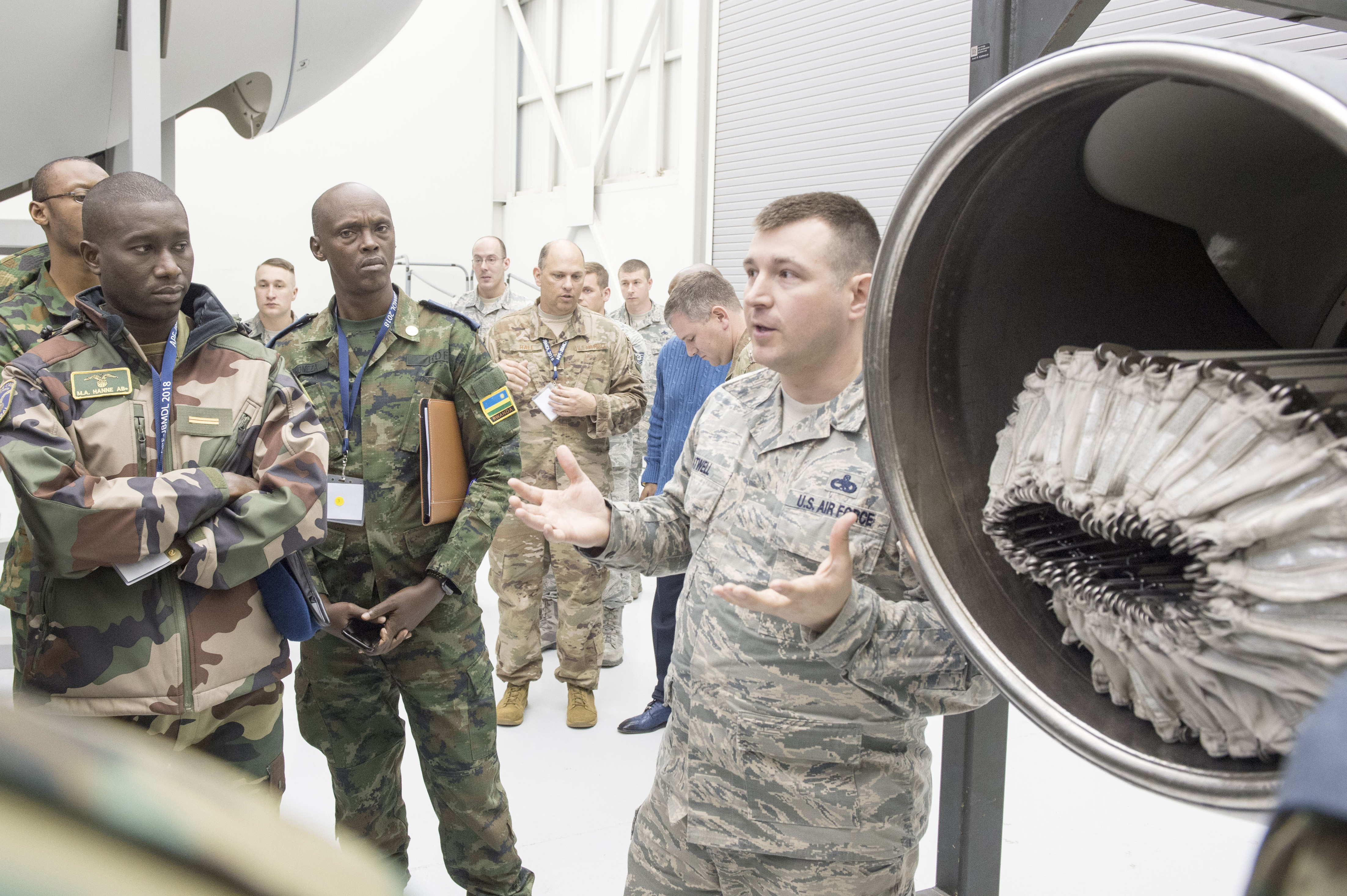 U.S. Air Force Master Sgt. David Atwell, 305th Maintenance Operations Squadron, briefs participants of the African Partnership Flight on refueling pods at Joint Base McGuire-Dix-Lakehurst, N.J., April 18, 2018. APF creates partnerships among a myriad of organizations who have not traditionally worked with each other in the past to achieve common interests through collaboration. (U.S. Air Force photo by Tech. Sgt. Gustavo Gonzalez)
