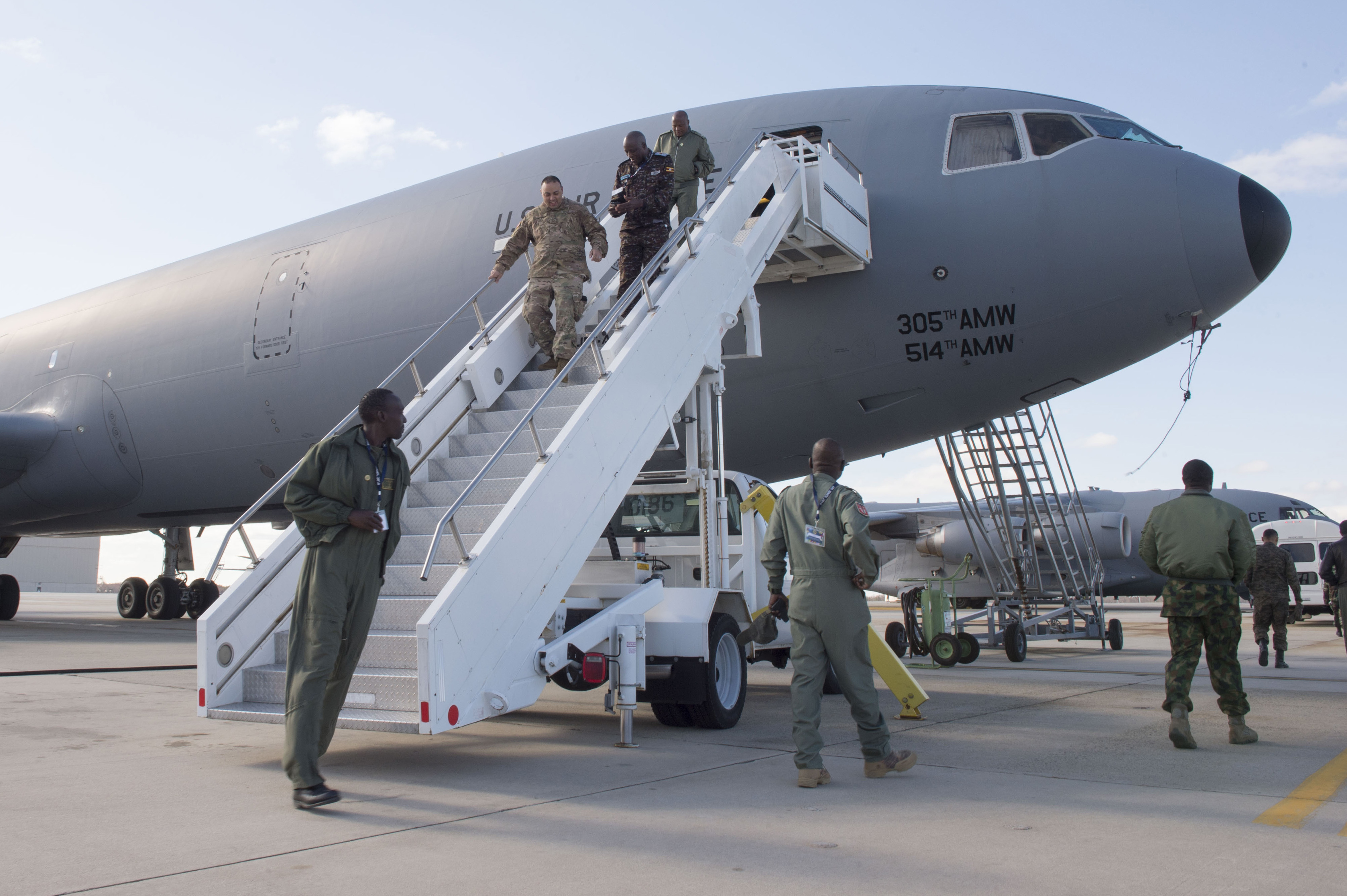 Participants of the African Partnership Flight disembark from a U.S. KC-10 Extender during a tour at Joint Base McGuire-Dix-Lakehurst, N.J., April 20, 2018. APF is sponsored and developed by U.S. Air Forces Africa and is the premier security cooperation program which partners the U.S. and African personnel to improve professional military aviation knowledge, skills, and cooperation. (U.S. Air Force photo by Tech. Sgt. Gustavo Gonzalez)
