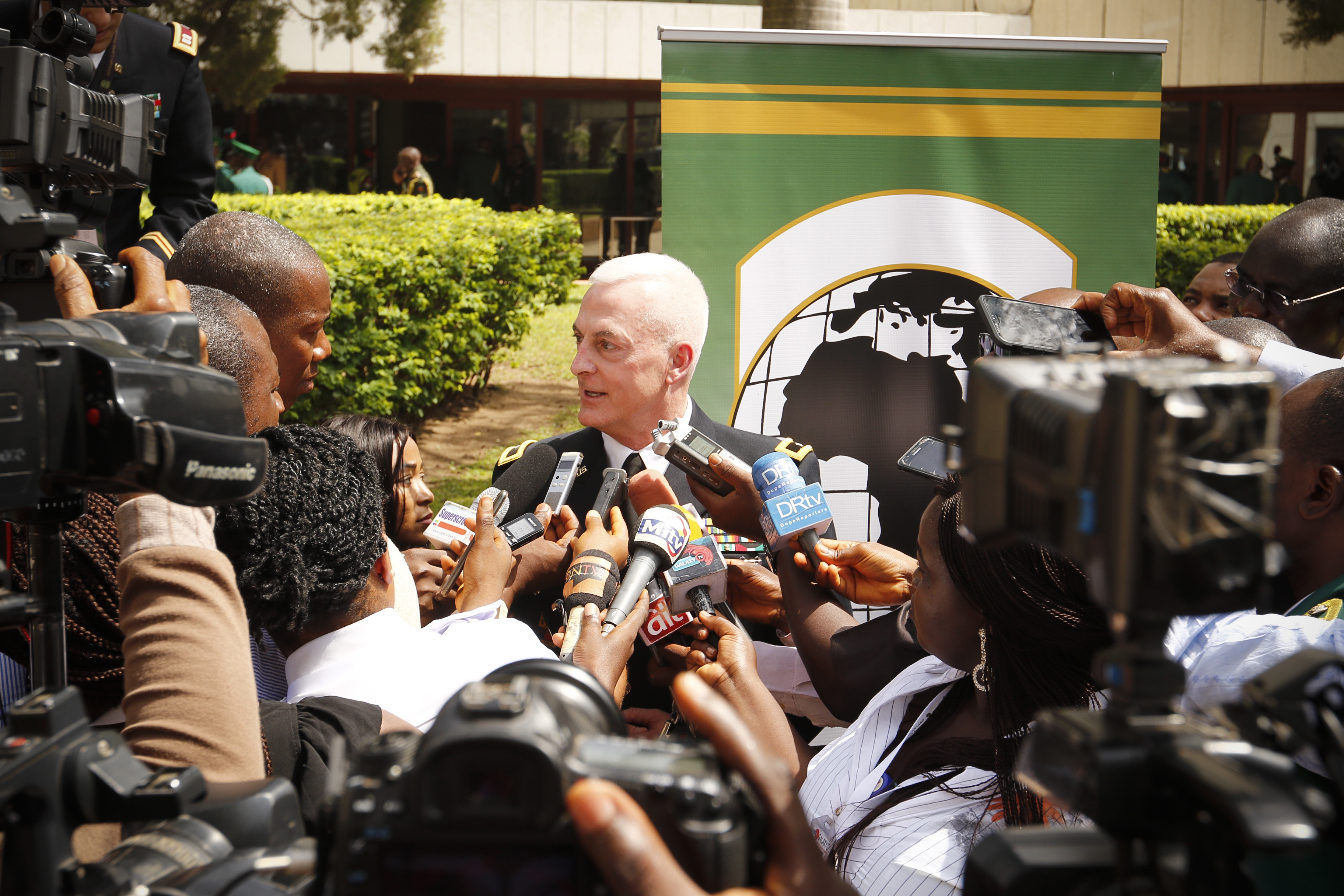 U.S. Army Brig. Gen. Eugene J. LeBoeuf, U.S. Army Africa acting commanding general, answers questions with local media during an interview following the opening ceremony of the African Land Forces Summit in Abuja, Nigeria, April 16, 2018. ALFS 18 participants will build capacity by utilizing th elesson learned during the  plenary sessions, breakout sessions and exchanges to combat violent extreme organizations. (U.S. Army photo by Staff Sgt. Joshua Tverberg)