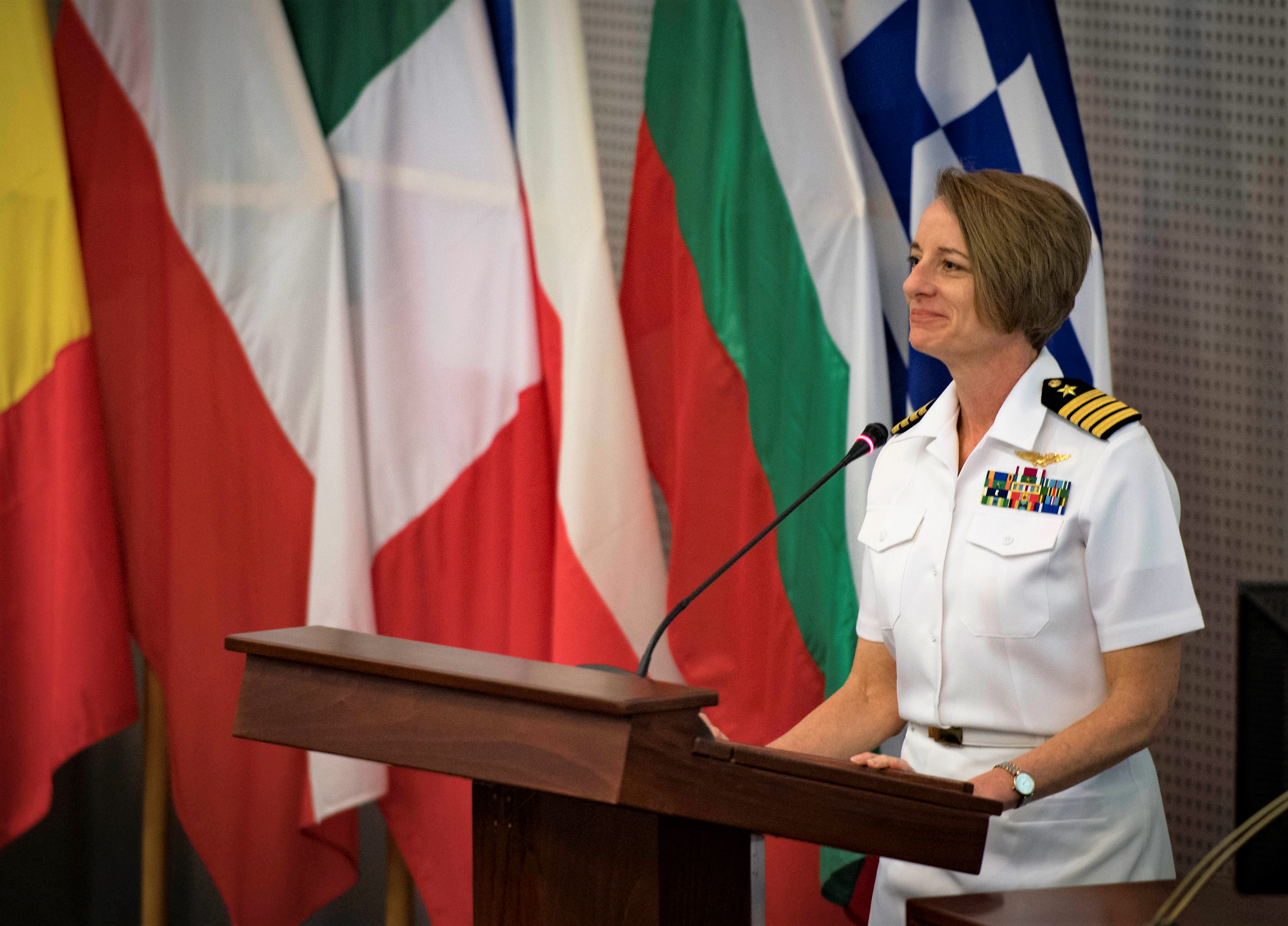 SOUDA BAY, Greece (May 3, 2018) Capt. Amy Egeli, exercise director of Phoenix Express 2018, delivers remarks at the exercise's pre-sail conference, May 3, 2018. Phoenix Express is sponsored by U.S. Africa Command and facilitated by U.S. Naval Forces Europe-Africa/U.S. 6th Fleet, and is designed to improve regional cooperation, increase maritime domain awareness information sharing practices, and operational capabilities to enhance efforts to achieve safety and security in the Mediterranean Sea. (U.S. Navy photo by Mass Communication Specialist 2nd Class Ryan U. Kledzik/Released)