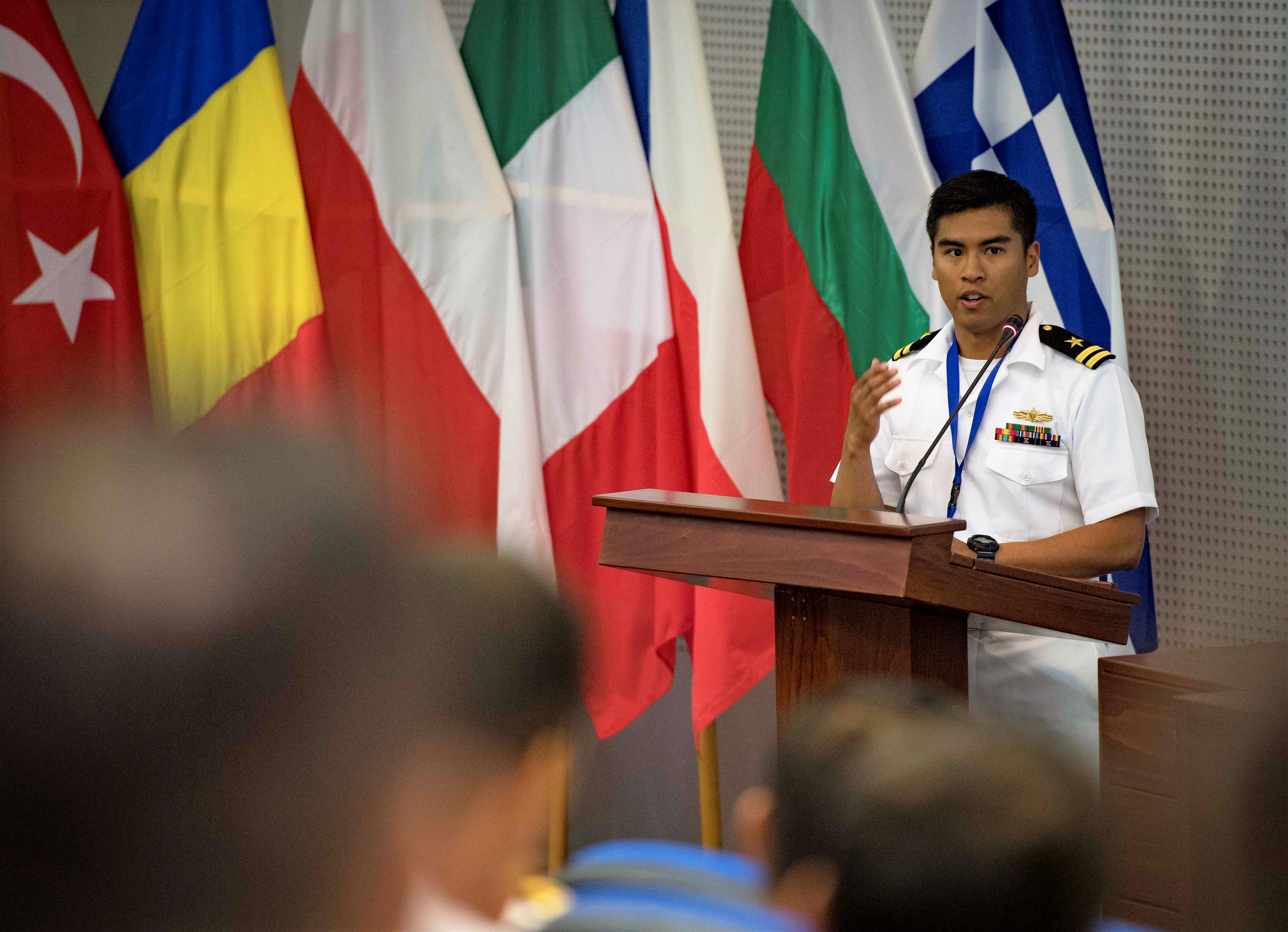 SOUDA BAY, Greece -- Lt. Irvin Pajarillo, exercise planner for exercise Phoenix Express 2018, delivers remarks at the exercise's pre-sail conference, May 3, 2018. Phoenix Express is sponsored by U.S. Africa Command and facilitated by U.S. Naval Forces Europe-Africa/U.S. 6th Fleet, and is designed to improve regional cooperation, increase maritime domain awareness information sharing practices, and operational capabilities to enhance efforts to achieve safety and security in the Mediterranean Sea. (U.S. Navy photo by Mass Communication Specialist 2nd Class Ryan U. Kledzik/Released)