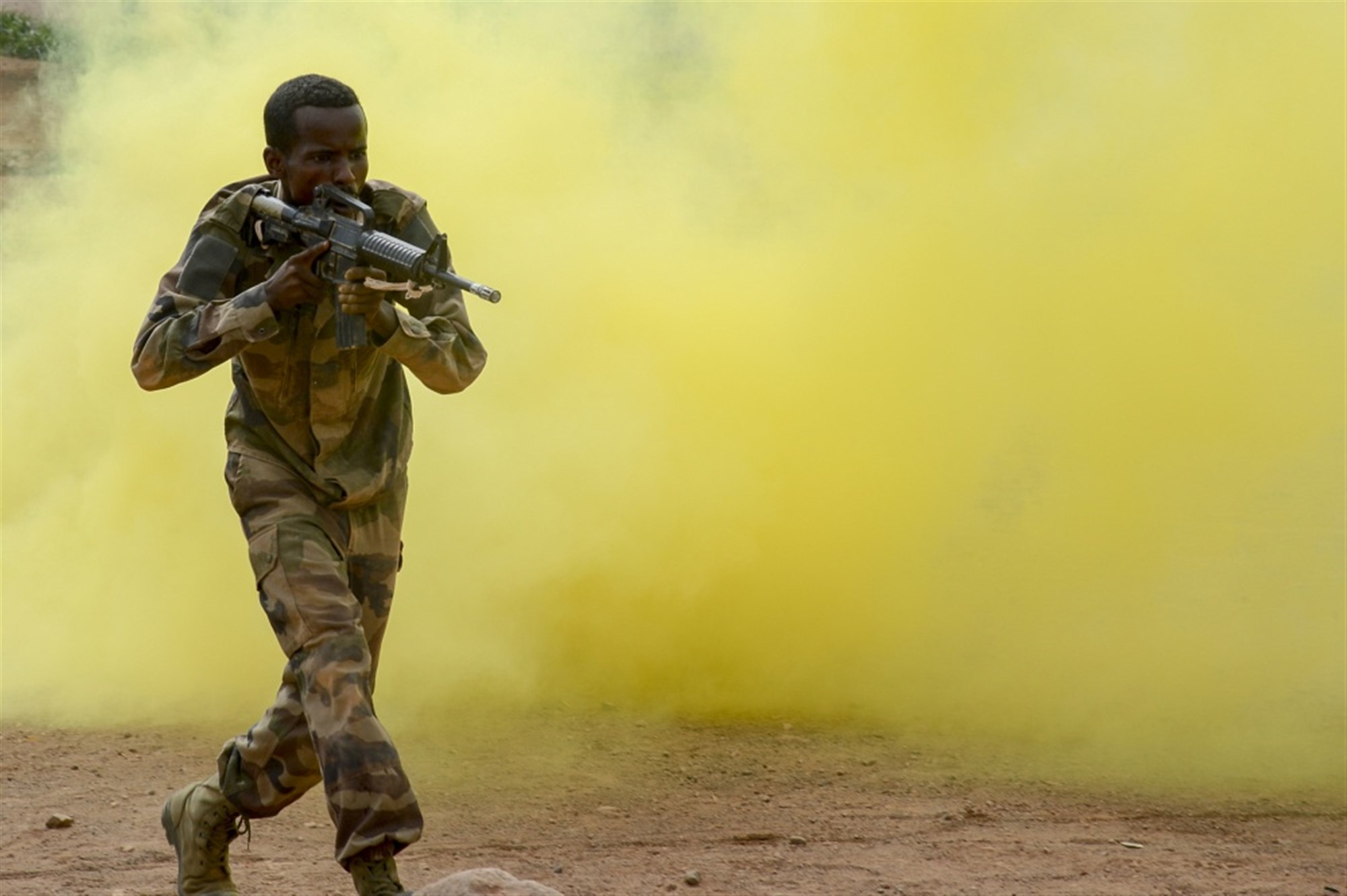 A Djiboutian soldier reacts to simulated contact during the culminating exercise of a five-week training cycle for the newly formed Rapid Intervention Battalion (RIB), a Djiboutian army crisis response unit, at a site outside Djibouti City, May 3, 2018. U.S. Army Soldiers from Alpha Company, 3rd Battalion, 141st Infantry Regiment, Texas National Guard, assigned to Combined Joint Task Force- Horn of Africa conducted the RIB training.