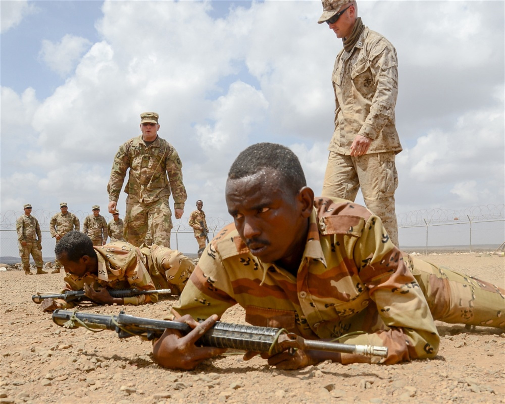 U.S. Army Sergeant Vincent Merriman, Alpha Company, 3rd Battalion, 141st Infantry Regiment, Texas National Guard, monitors Djiboutian soldiers during a react-to-fire exercise at a training site outside Djibouti City, April 16, 2018. U.S. service members have been training the Djiboutian Army's Rapid Intervention Battalion, a newly formed crisis response unit.