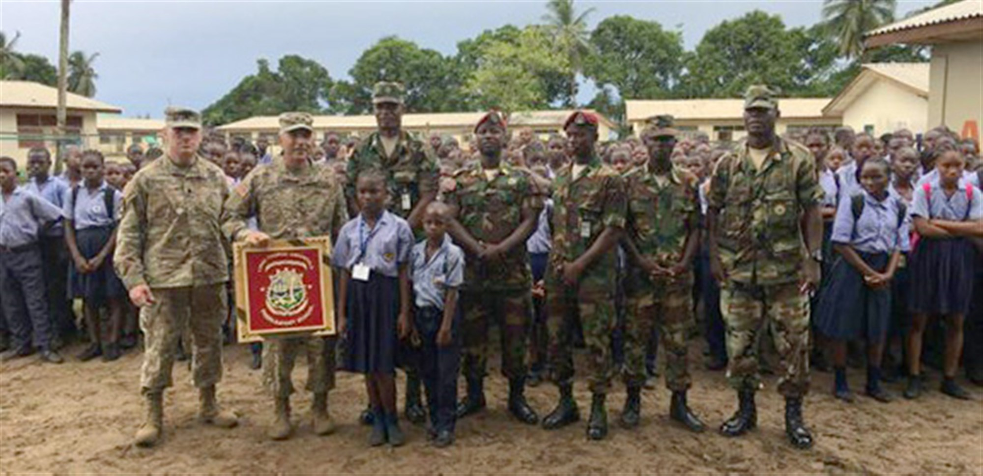 MONROVIA, Liberia --During a visit to the Linda Thomas Greenfield Preparatory School, Maj. Gen. Gregory Vadnais, the adjutant general of the Michigan National Guard, was presented with a plaque in appreciation of his support to the Edward Binyah Kesselly facility and the families of the Armed Forces of Liberia. The children greeted him in their classrooms and showed him what they were learning. (Photo courtesy of Michigan National Guard)