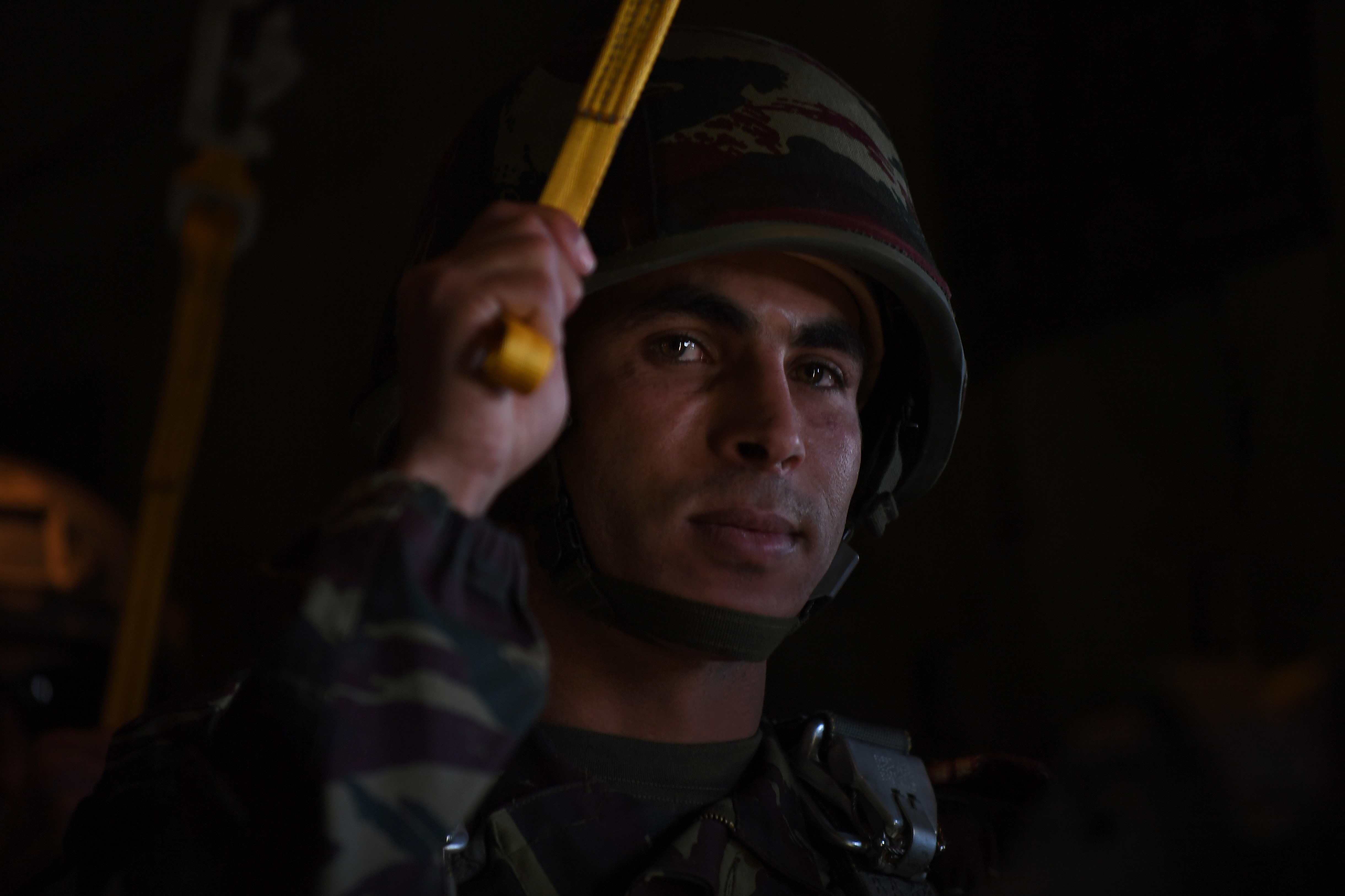 A Royal Moroccan Armed Forces paratrooper prepares for a personnel drop during Exercise African Lion 18, April 16, 2018 near Kenitra Air Base. Approximately 900 U.S. military personnel have arrived in the Kingdom of Morocco to join nearly 400 members of the Royal Moroccan Armed Forces to take part in Exercise African Lion 18. (U.S. Air Force photo by Staff Sgt. Nesha Humes Stanton)